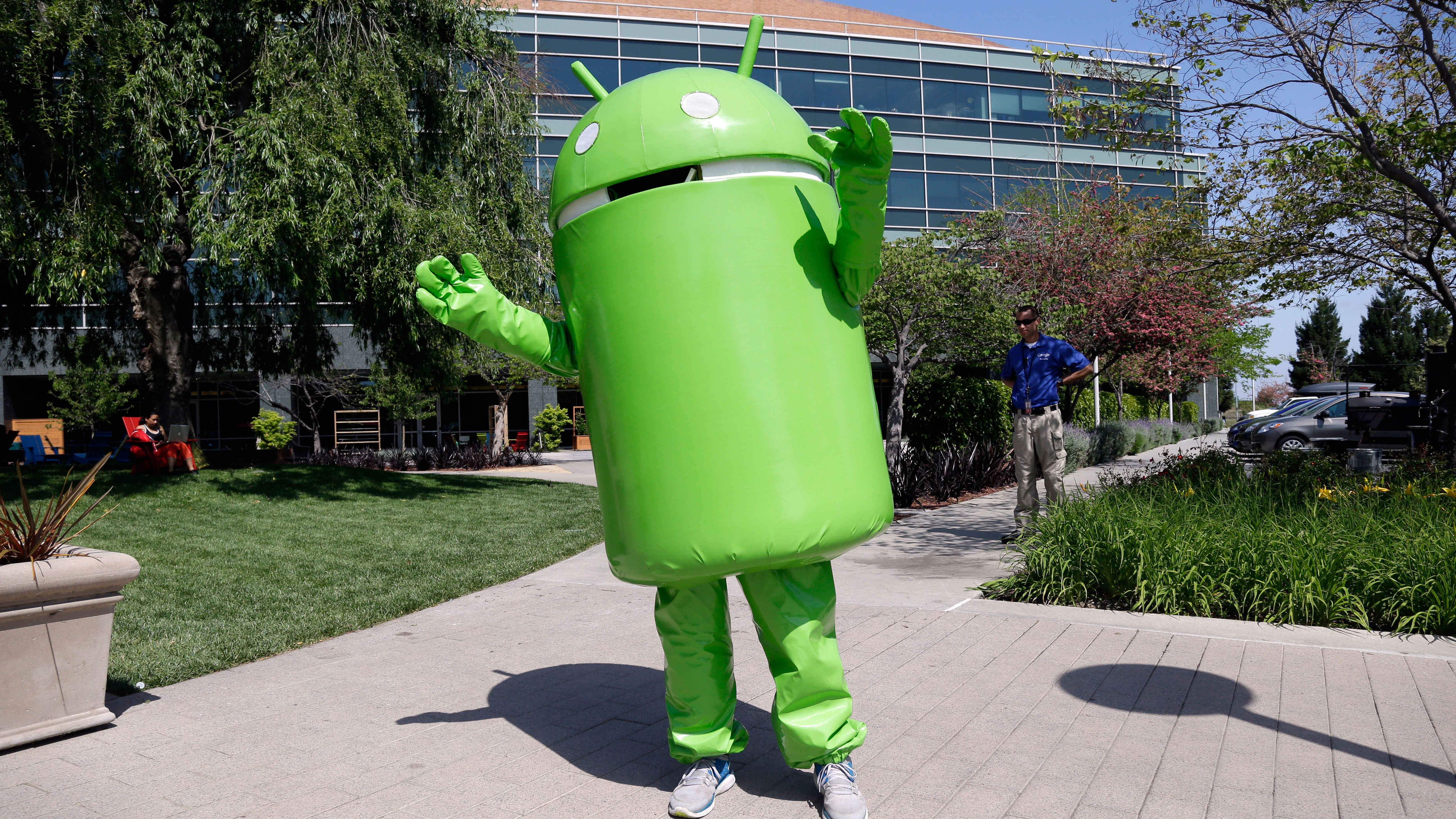 A person costumed as the Android operating system mascot greets visitors at Google headquarters in Mountain View, Calif., Thursday, April 25, 2013. (AP Photo/Marcio Jose Sanchez)