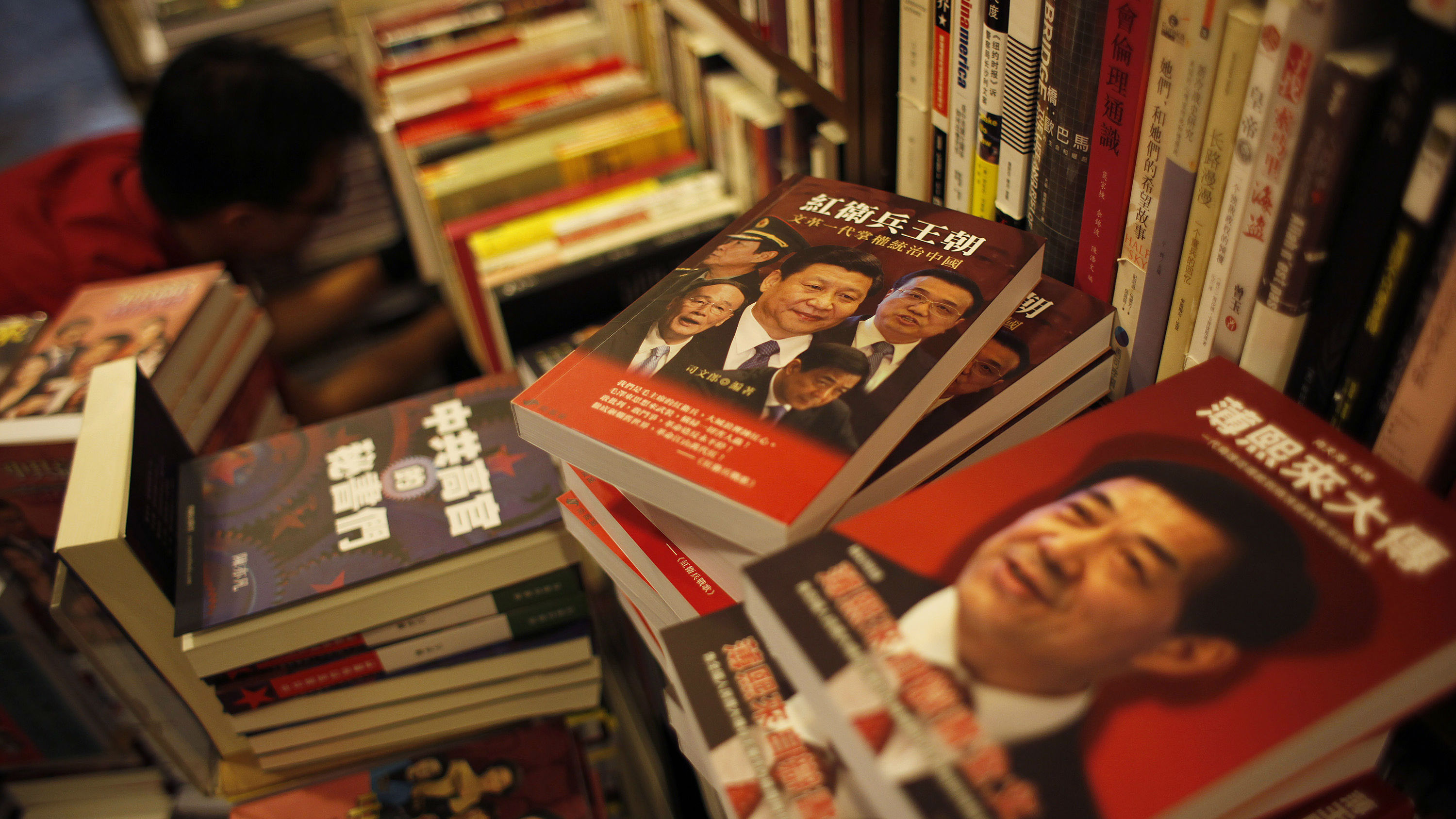 DATE IMPORTED:November 08, 2012Books on the arrested Chinese official Bo Xilai (R) and potential new Chinese leaders are displayed inside a bookstore in Hong Kong, which sells books that banned in mainland China, November 6, 2012. Books banned in China have been flying off the shelves in Hong Kong in the run-up to China's leadership transition as mainland people seek insight into the decision makers who will run their country and the rivals who have fallen out of favour. Picture taken November 6, 2012. REUTERS/Bobby Yip (CHINA - Tags: POLITICS SOCIETY)