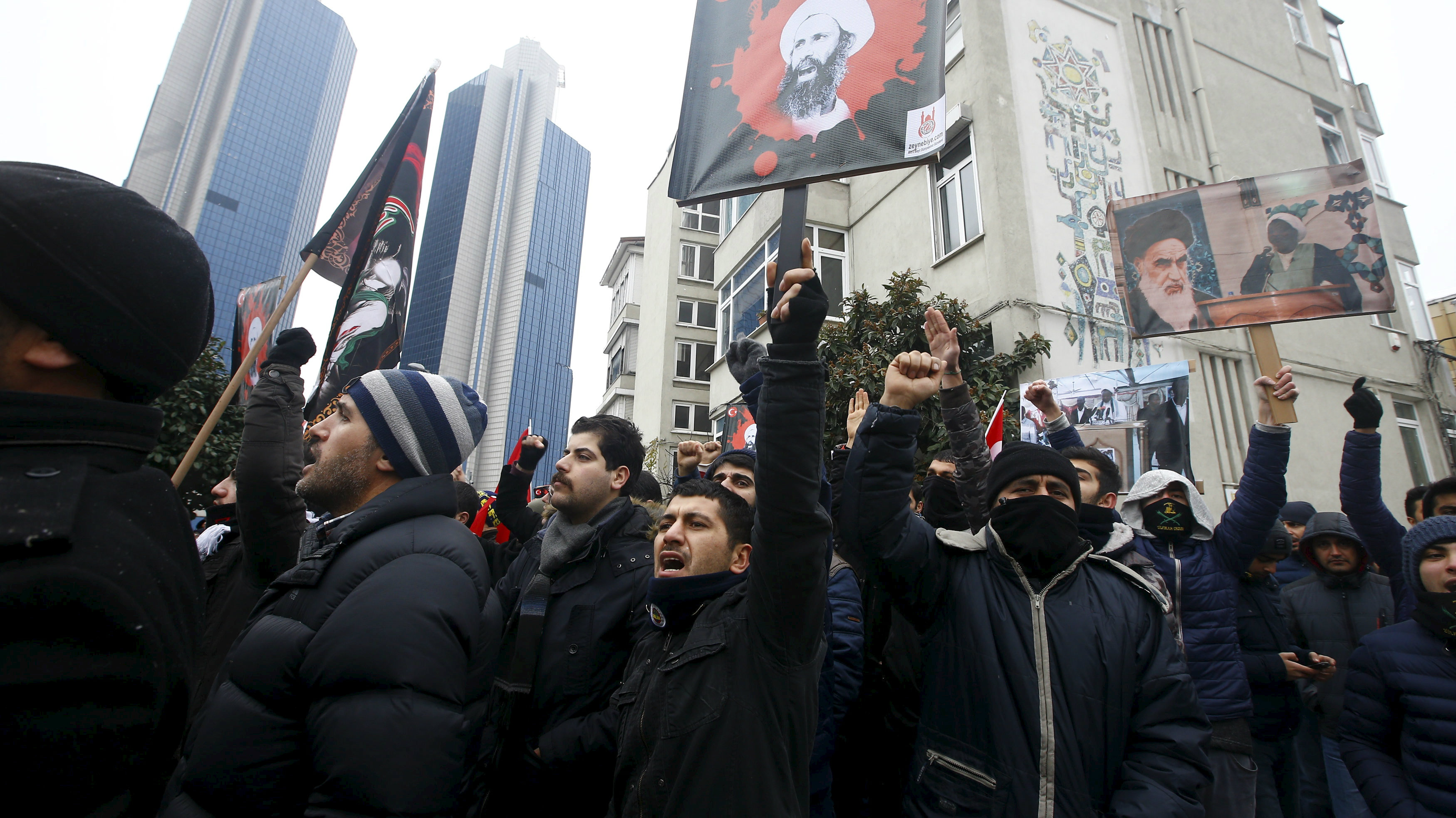 Shi'ite protesters carry posters of Sheikh Nimr al-Nimr during a demonstration in front of Saudi Arabia's Consulate in Istanbul, Turkey, January 3, 2016.