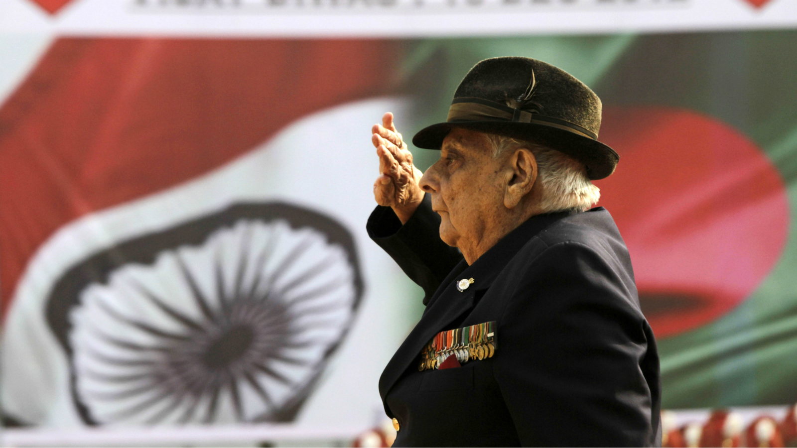 Indian Army retired Lieutenant Colonel and a 1971 war hero J.F.R. Jacob, salutes at the martyrs' column during Victory Day celebrations in Kolkata, India, Sunday, Dec. 16, 2012. The Indian Army celebrates Victory Day on December 16, to commemorate its victory over Pakistan in 1971, which gave birth of a new nation Bangladesh. (AP Photo/Bikas Das)