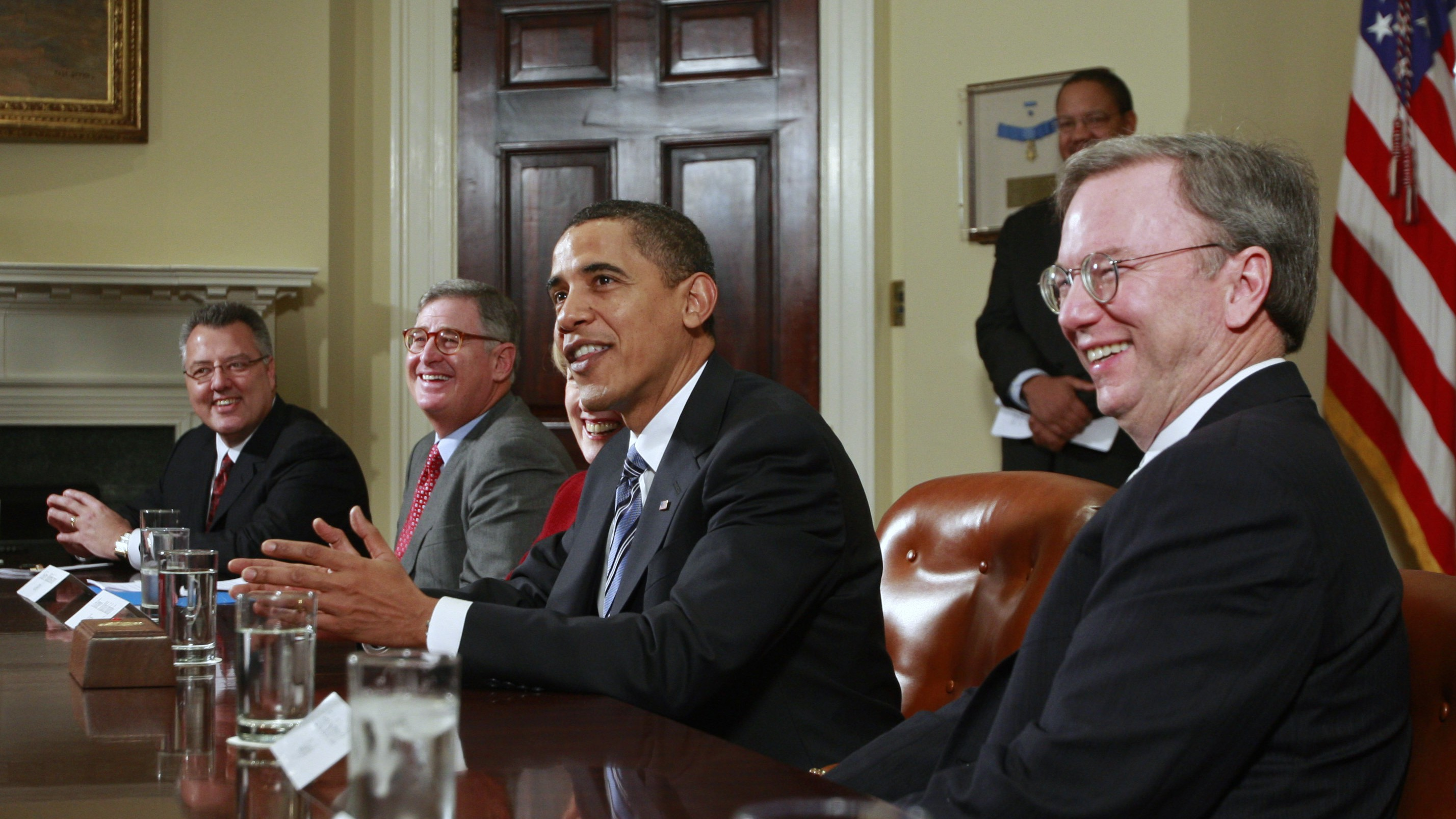 U.S. President Barack Obama (C) speaks to the media alongside Google CEO Eric Schmidt (R) and other company CEOs during an economic meeting in the Roosevelt Room of the White House in Washington January 28, 2009. REUTERS/Jason Reed (UNITED STATES) - RTR23ZCJ