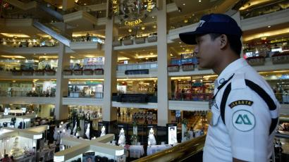 An Indonesian security guard watches over a shopping mall in Jakarta.