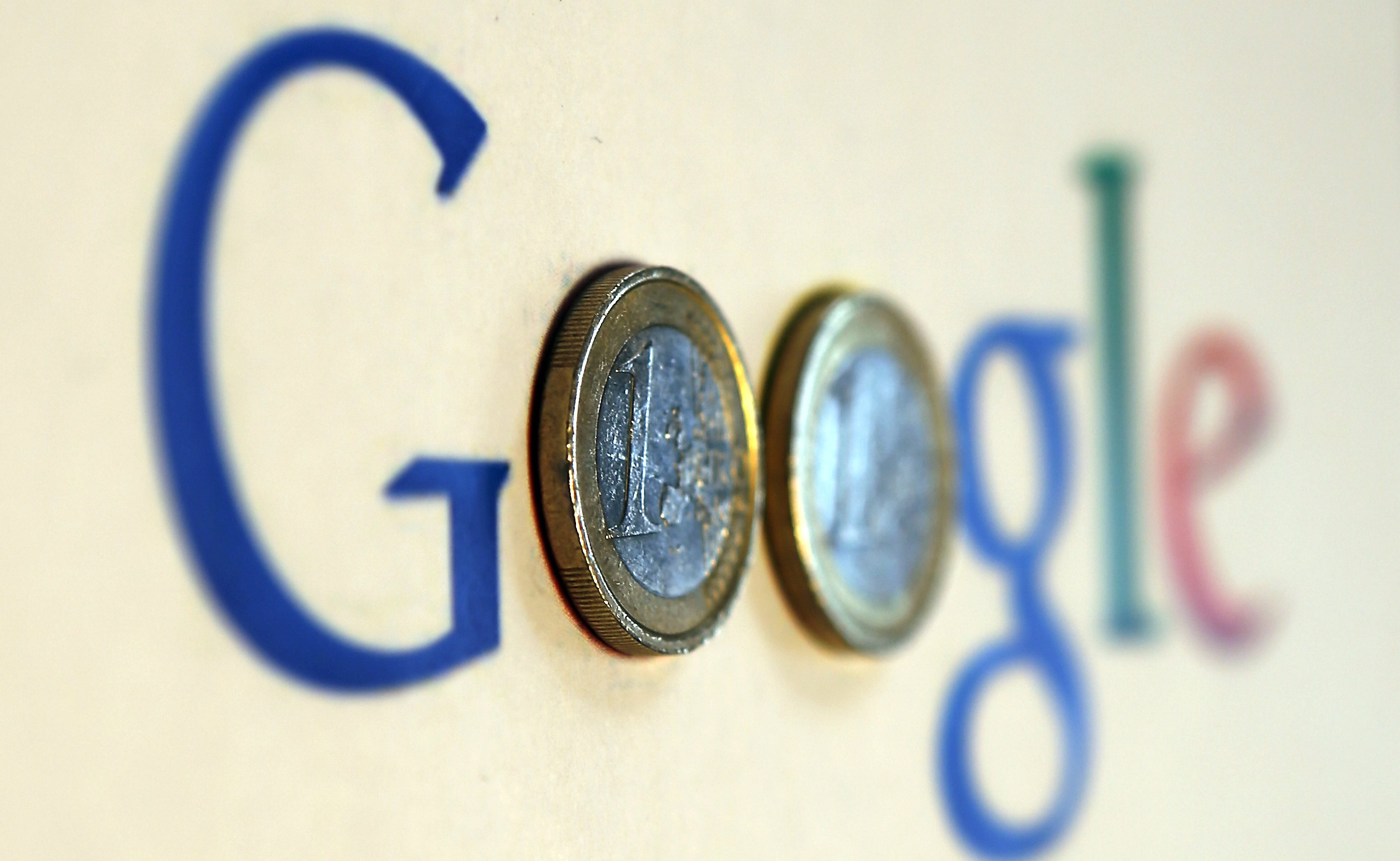 An illustration picture shows a Google logo with two one Euro coins, taken in Munich January 15, 2013.   REUTERS/Michael Dalder  (GERMANY - Tags: BUSINESS SCIENCE TECHNOLOGY) - RTR3CH3L