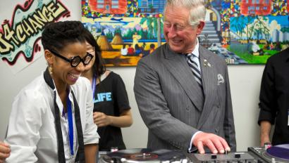 Prince Charles smiles as he learns to scratch on a Technics 1200 in Toronto in 2012