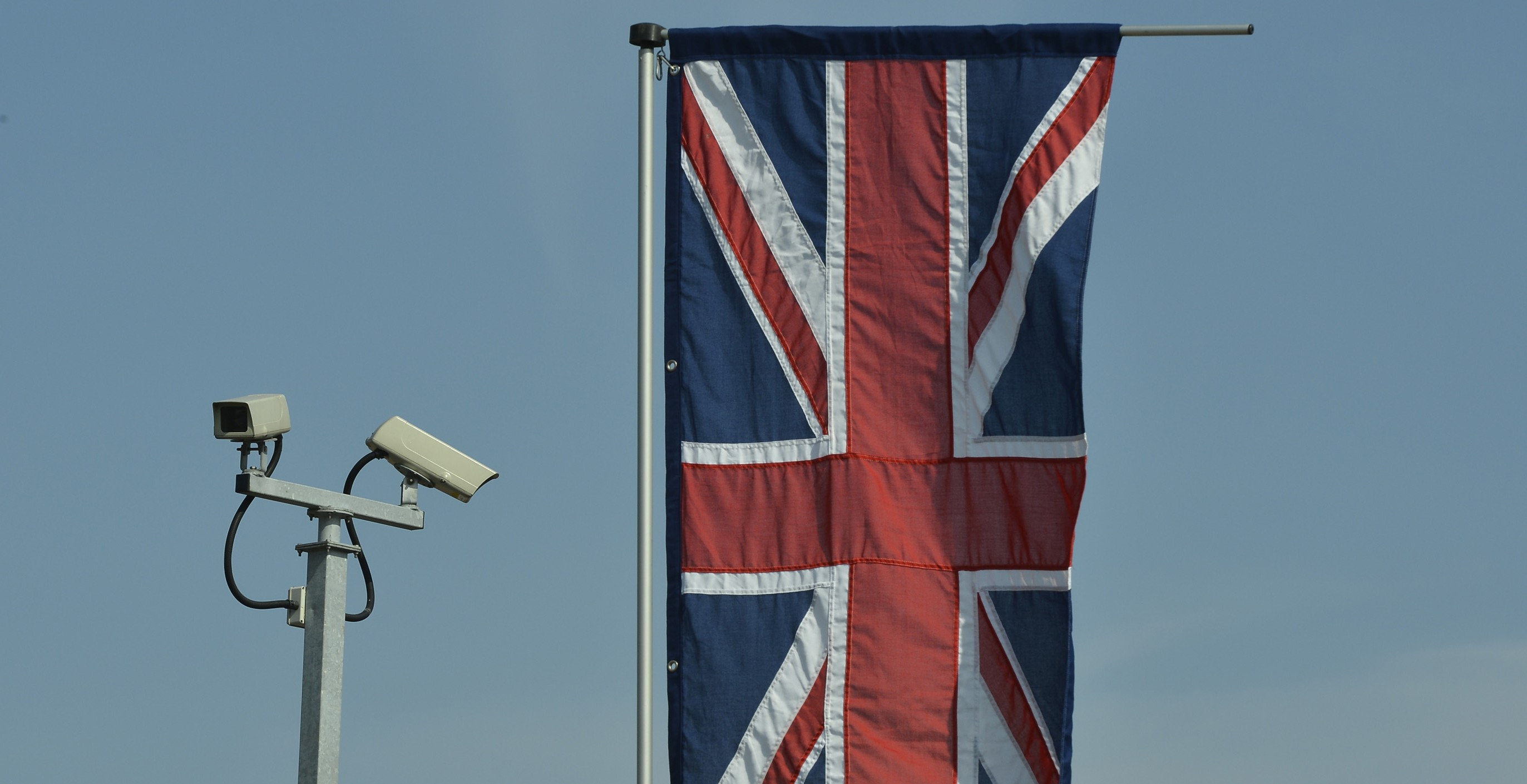 Security cameras and a British Union flag are seen outside the Krishna Avanti School, before a visit by Britain's Queen Elizabeth, in Edgware in north London
