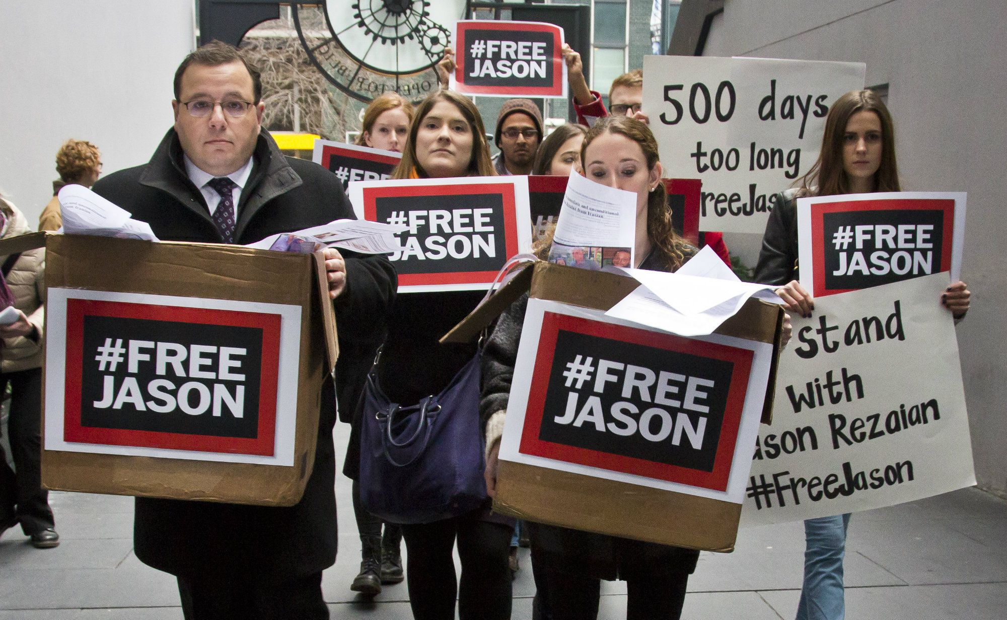 Ali Rezaian, far left, the brother of Washington Post reporter Jason Rezaian, rallies with supporters to deliver a petition of 500,000 signatures to Iran's United Nations mission asking for the release of his brother from prison, Thursday, Dec. 3, 2015, in New York. Thursday marks the 500th day of journalist Jason Rezaian's detention. Iranian TV reports he's been sentenced to prison on charges that include espionage. (AP Photo/Bebeto Matthews)