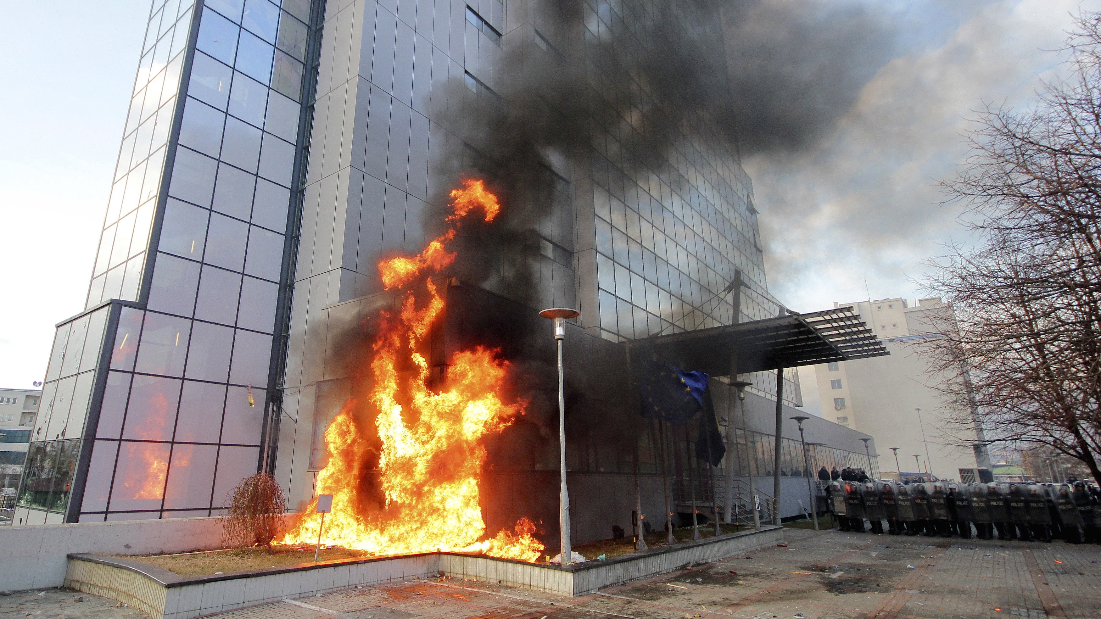 A portion of the national government headquarters in Pristina, Kosovo, burns.