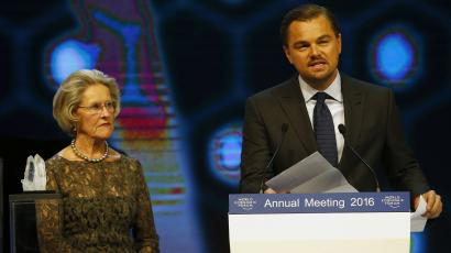 Actor Leonardo DiCaprio (R) delivers a speech after receiving a Crystal Award for his contribution to improve the state of the world from Hilde Schwab during the annual meeting of the World Economic Forum (WEF) in Davos, Switzerland January 19, 2016. REUTERS/Ruben Sprich