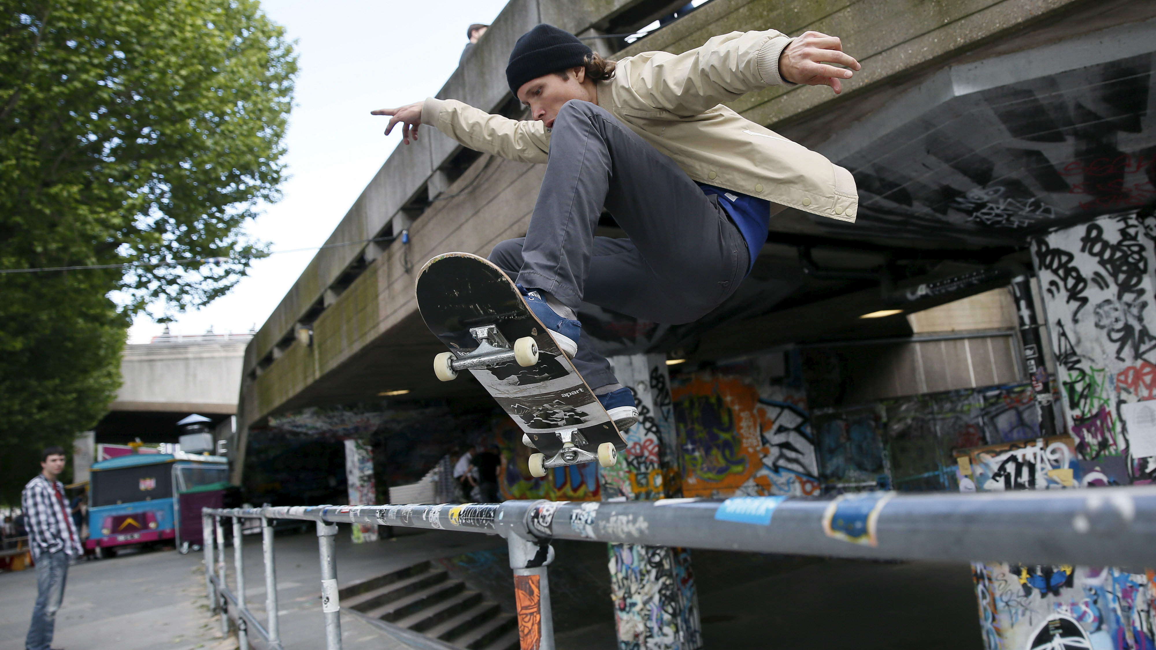A skateboarder performs a jump over a railing at Southbank in central London, Britain June 3, 2015. REUTERS/Stefan Wermuth