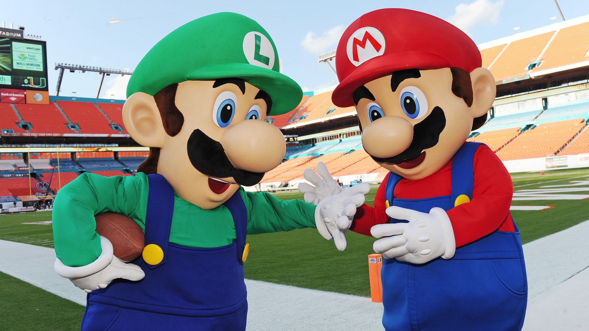 IMAGE DISTRIBUTED FOR NINTENDO - Mario and Luigi take the field at Sun Life Stadium before the face-off between Florida State and University of Miami on Nov. 15, 2014. The two video game icons were in town to show football fans Super Smash Bros. for Nintendo 3DS and the forthcoming Super Smash Bros. for Wii U. Nintendo of America is bringing these all-star brawling games to college campuses across the country this fall as a part of the College Tailgate Tour.(Photo By Jeff Daly/Invision for Nintendo/AP)