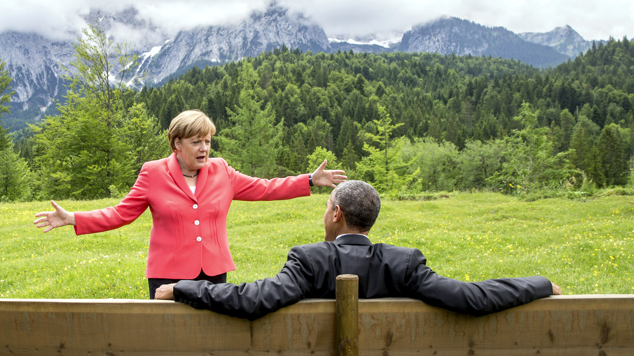German Chancellor Angela Merkel speaks with U.S. President Barack Obama outside the Elmau castle in Kruen near Garmisch-Partenkirchen, Germany, June 8, 2015. Leaders of the Group of Seven (G7) industrial nations vowed at a summit in the Bavarian Alps on Sunday to keep sanctions against Russia in place until President Vladimir Putin and Moscow-backed separatists fully implement the terms of a peace deal for Ukraine.