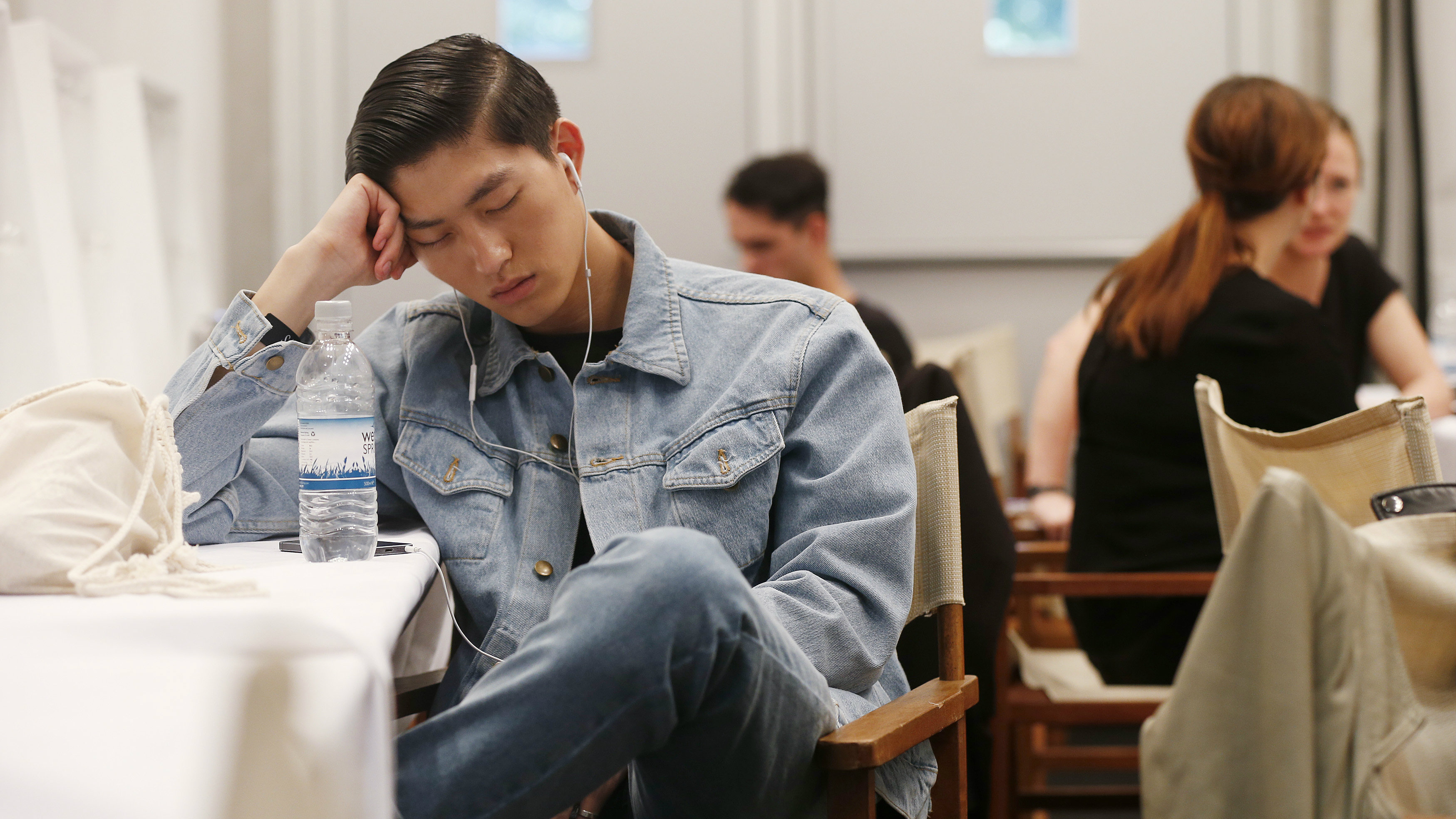 A model naps backstage before the presentation of Burberry Prorsum during its London Collections: Men show in London June 17, 2014. REUTERS/Suzanne Plunkett (BRITAIN - Tags: FASHION)