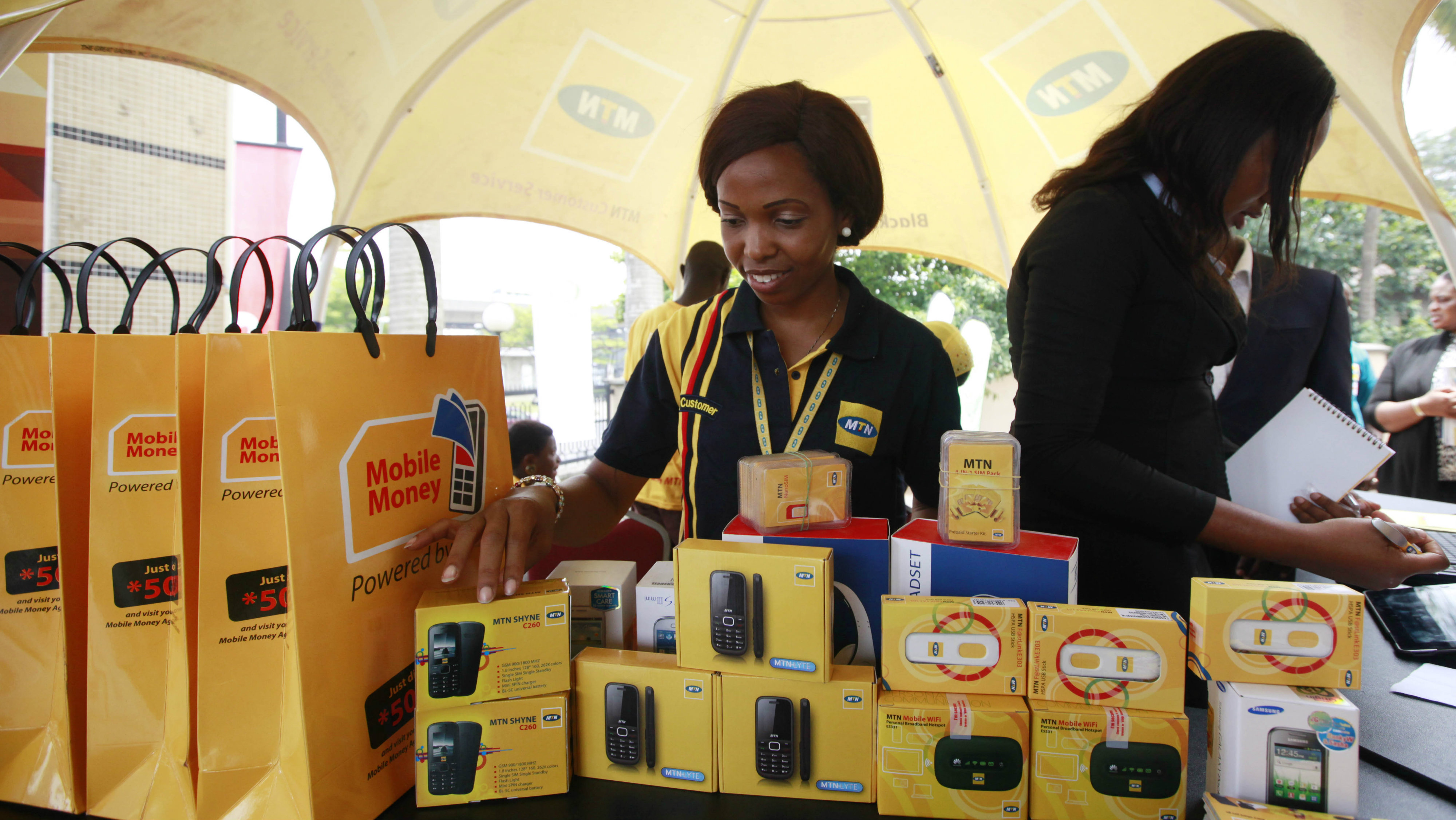 Staff of MTN's Nigeria, during the launch of mobile number portability in Lagos, Nigeria, Monday, April 22, 2013. Mobile phone users in Nigeria can now keep their old number when switching services, a major shakeup in the West African nation's lucrative telecommunications market where customers often complain of poor service. The service, pushed by the federal Nigerian Communications Commission, began Monday across the nation of more than 160 million people. Under the service, customers can keep their number and can switch providers every 90 days for free. (AP Photo/Sunday Alamba)