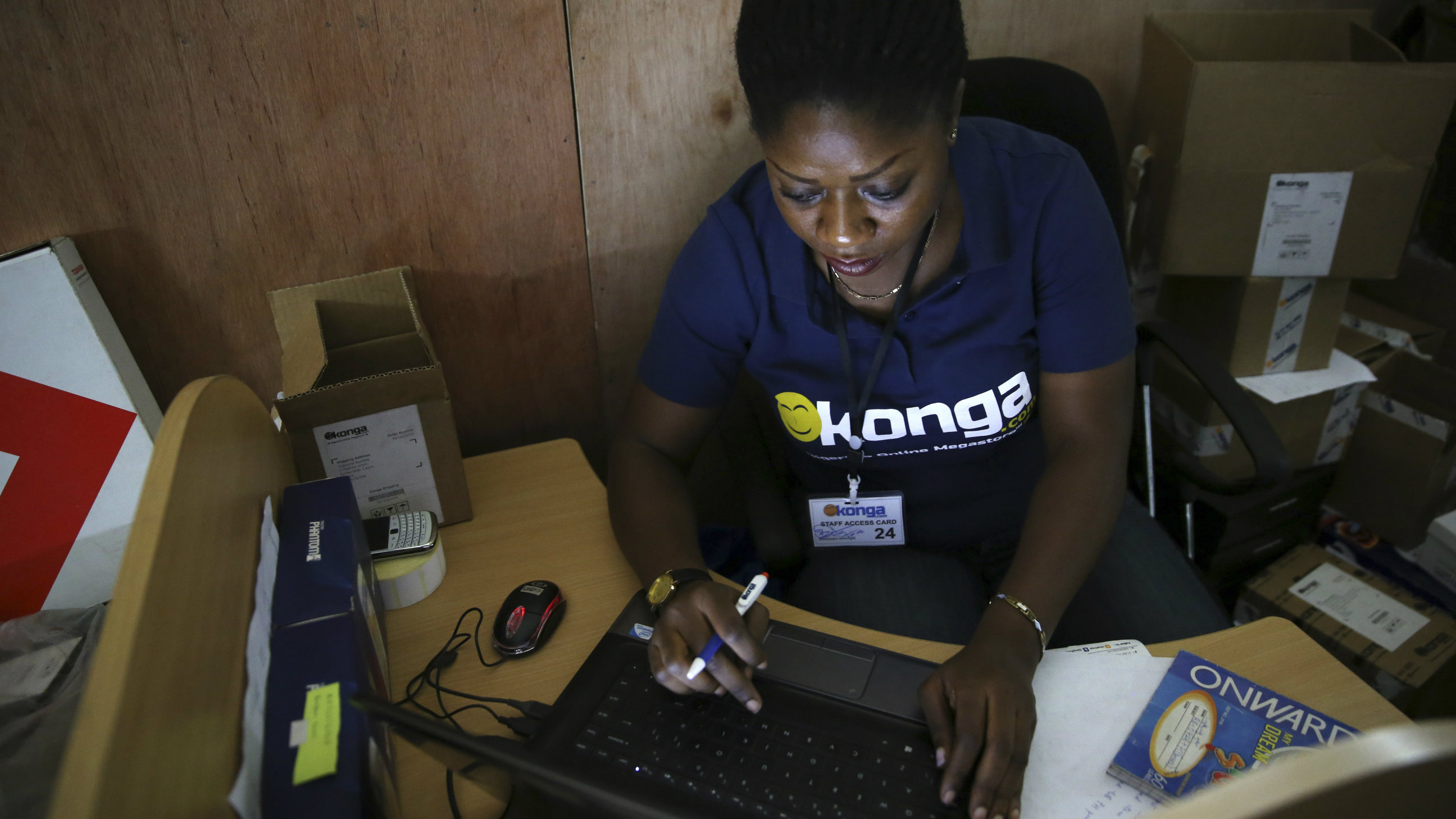 A staff inputs data into a computer at the warehouse of Konga online shopping company in Ilupeju district in Nigeria's commercial capital Lagos September 13, 2013. REUTERS/Akintunde Akinleye(NIGERIA - Tags: BUSINESS EMPLOYMENT)