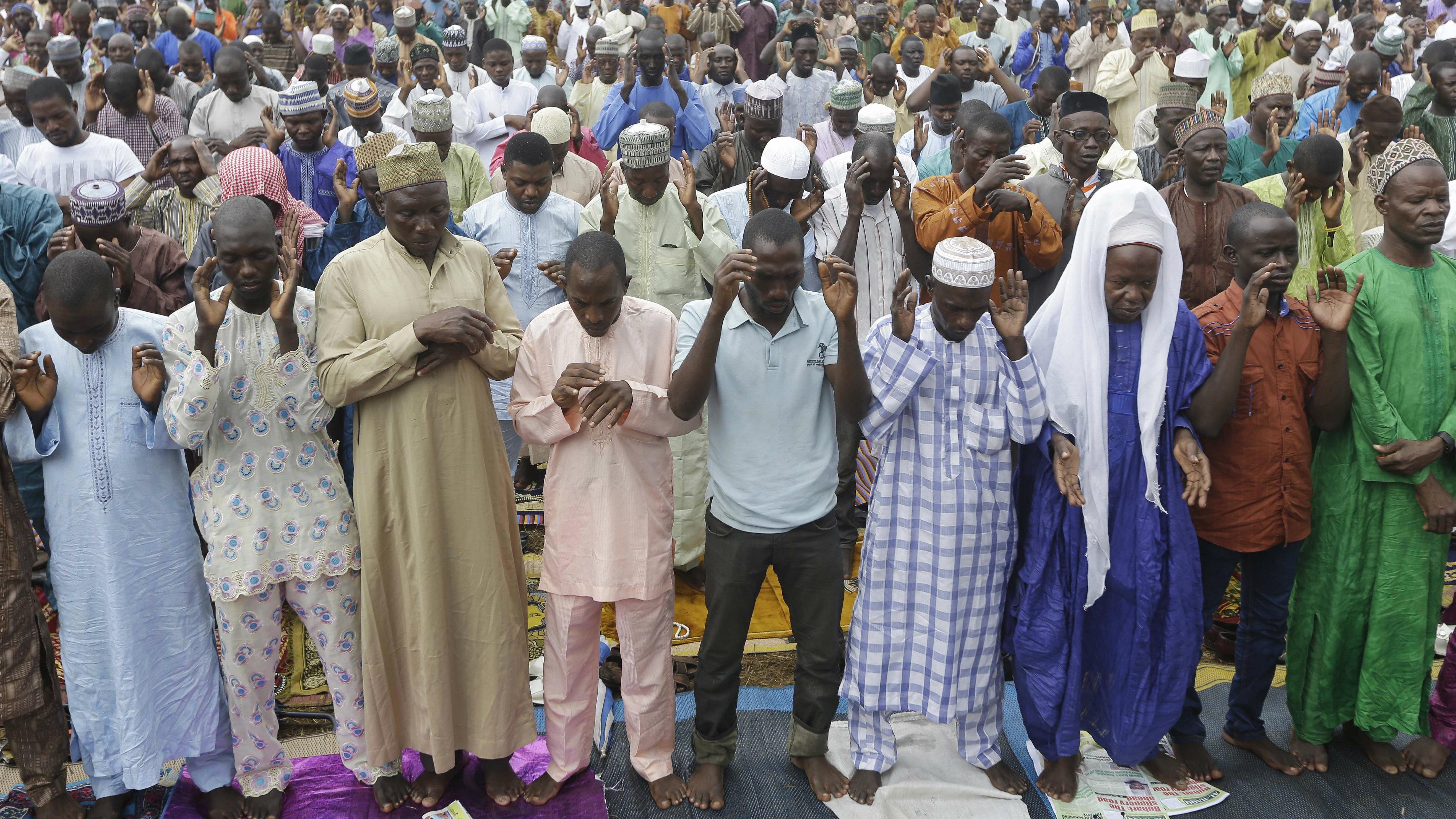 Nigeria Muslims attend Eid al-Fitr prayer in Lagos, Nigeria, Friday July 17, 2015, marking the end of the Muslim holy fasting month of Ramadan. (AP Photo/Sunday Alamba)