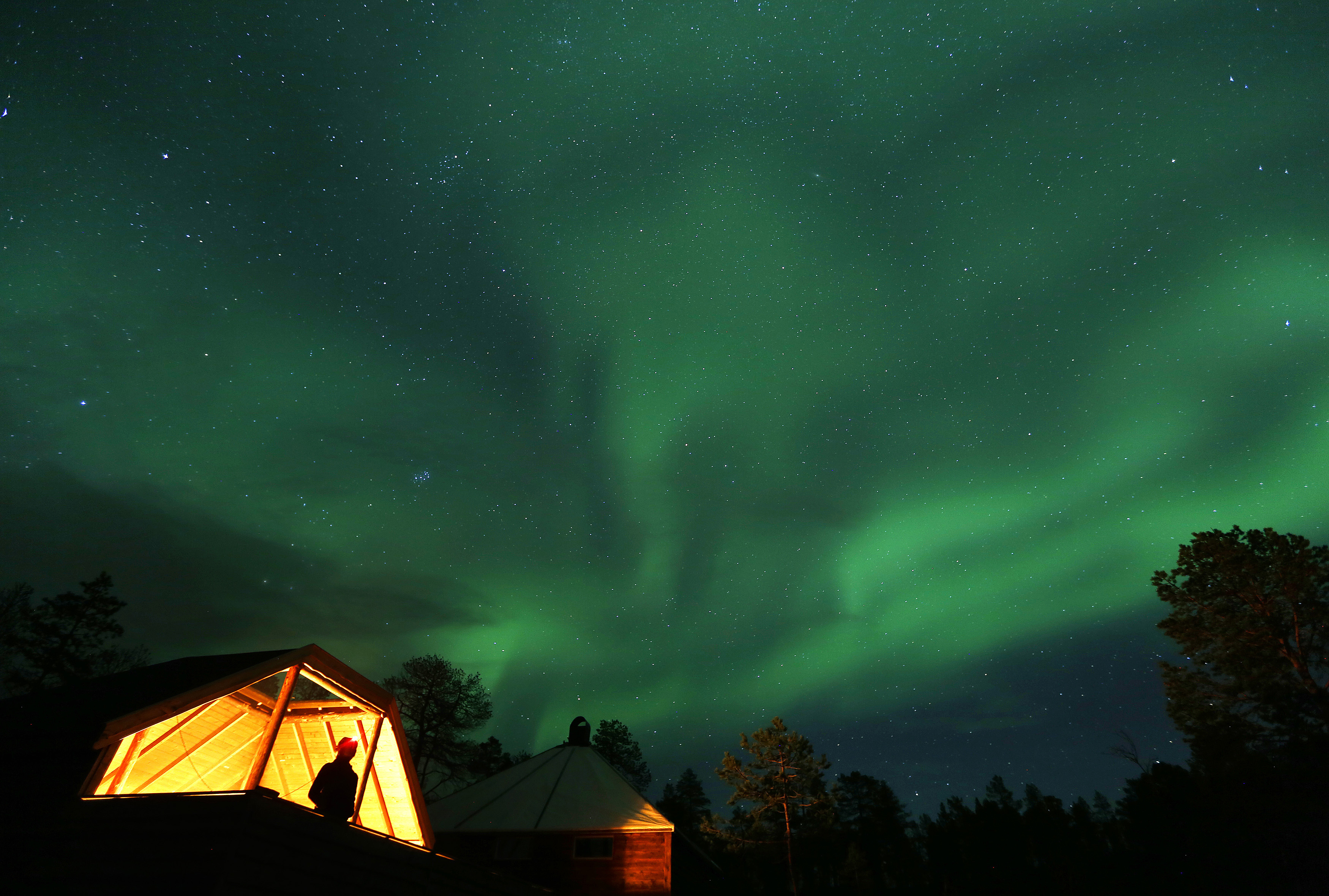 The Aurora Borealis (Northern Lights) is seen over a mountain camp north of the Arctic Circle, near the village of Mestervik early October 2, 2014. REUTERS/Yannis Behrakis (NORWAY - Tags: ENVIRONMENT TRAVEL)