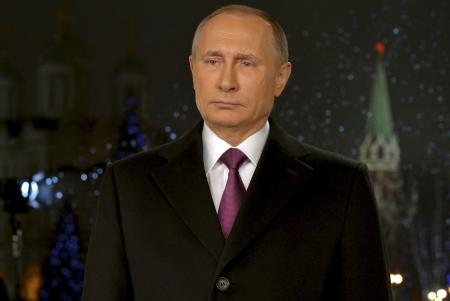 Russian President Vladimir Putin looks on as he delivers his annual New Year address to the nation in Moscow, December 31, 2015.