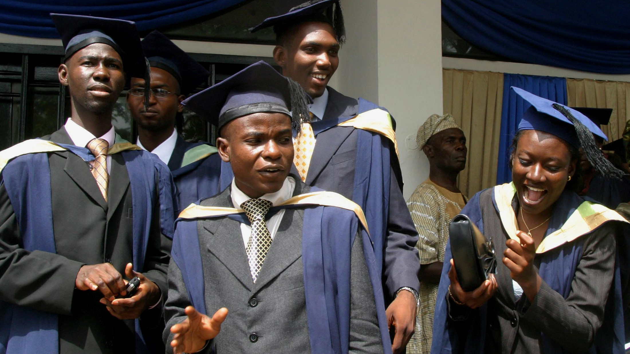 Students of the University of Ibadan check their graduation gowns in their campus in Ibadan, south west Nigeria, November 15, 2006