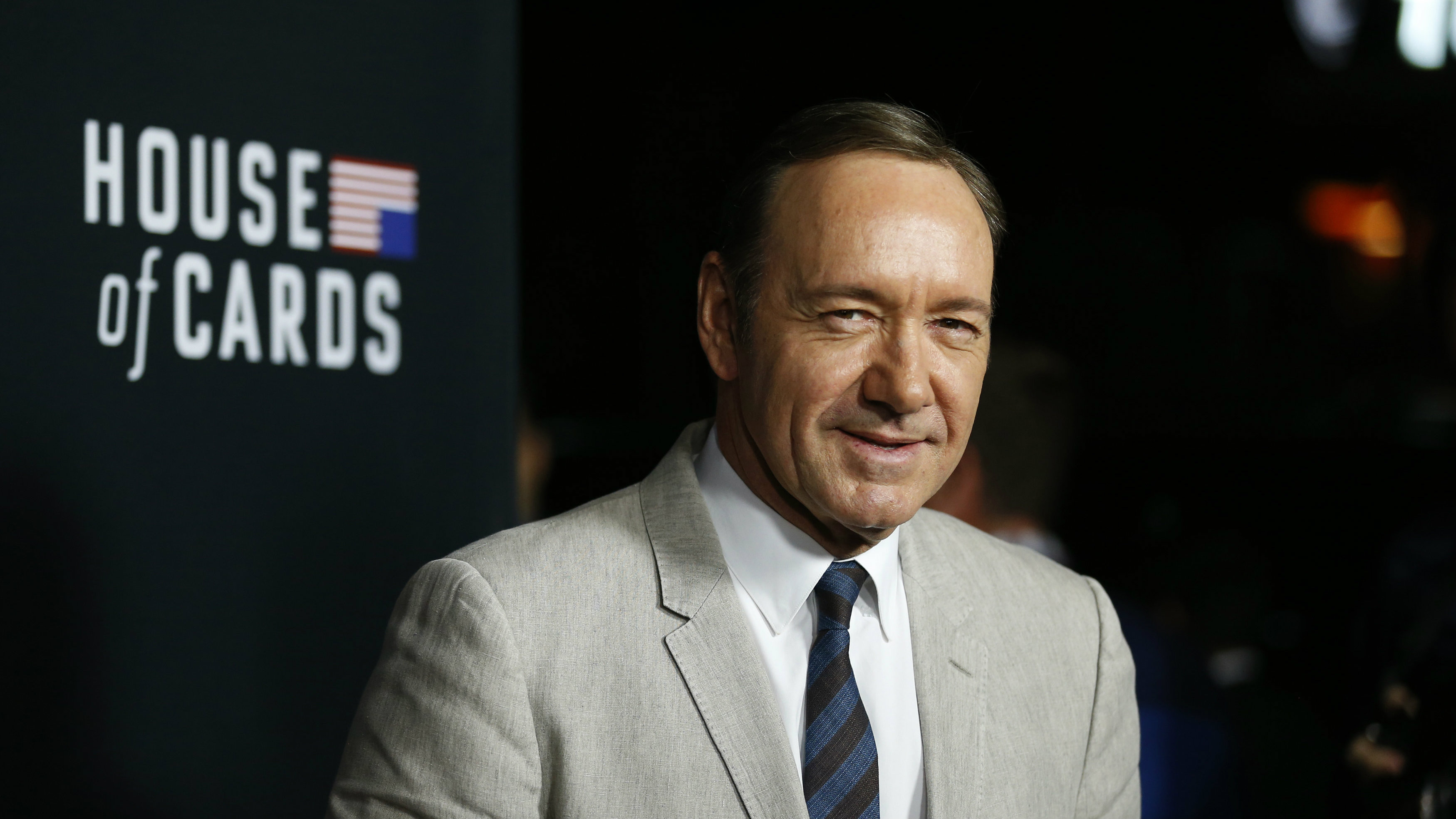 """Cast member Kevin Spacey poses at the premiere for the second season of the television series """"House of Cards"""" at the Directors Guild of America in Los Angeles, California February 13, 2014."""