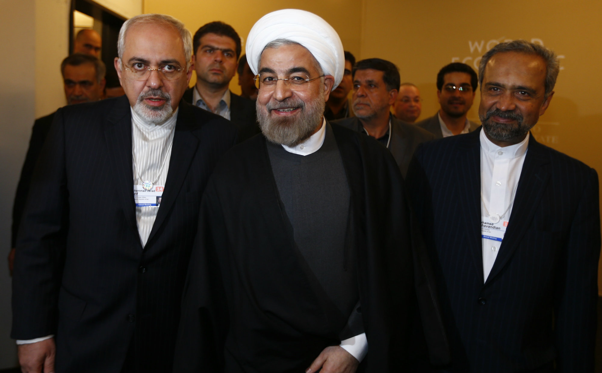 Iran's President Hassan Rouhani, Foreign Minister Mohammad Javad Zarif (L) and Mohammad Nahavandian the Head of Iran Presidential Office (R) arrive for a meeting during the annual meeting of the World Economic Forum (WEF) in Davos January 22, 2014. REUTERS/Denis Balibouse