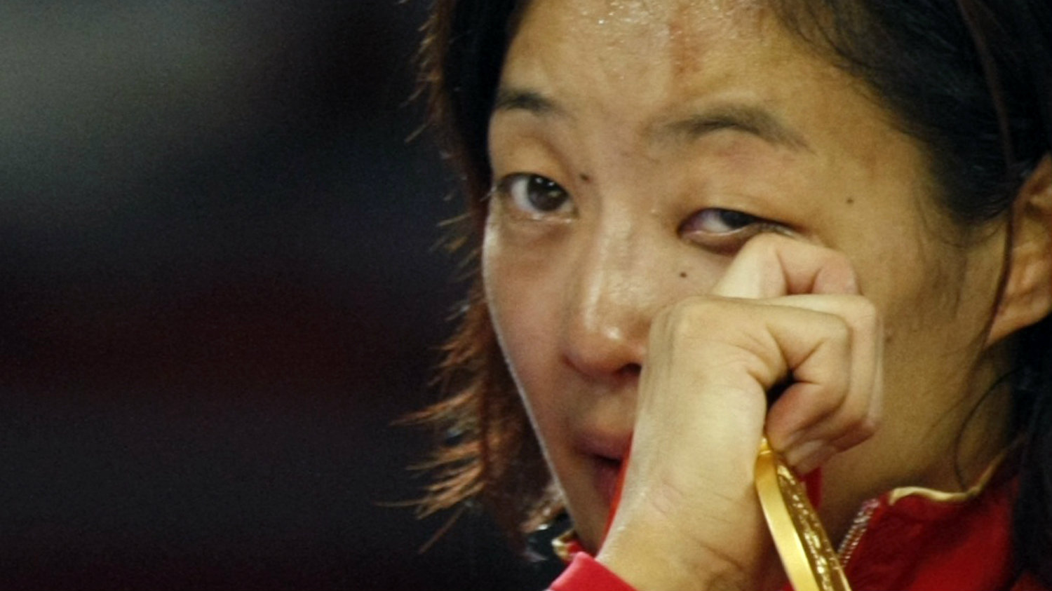 Carol Huynh of Canada sheds tears of joy after winning the gold medal in the 48kg women's freestyle wrestling at the Beijing 2008 Olympic Games August 16, 2008.