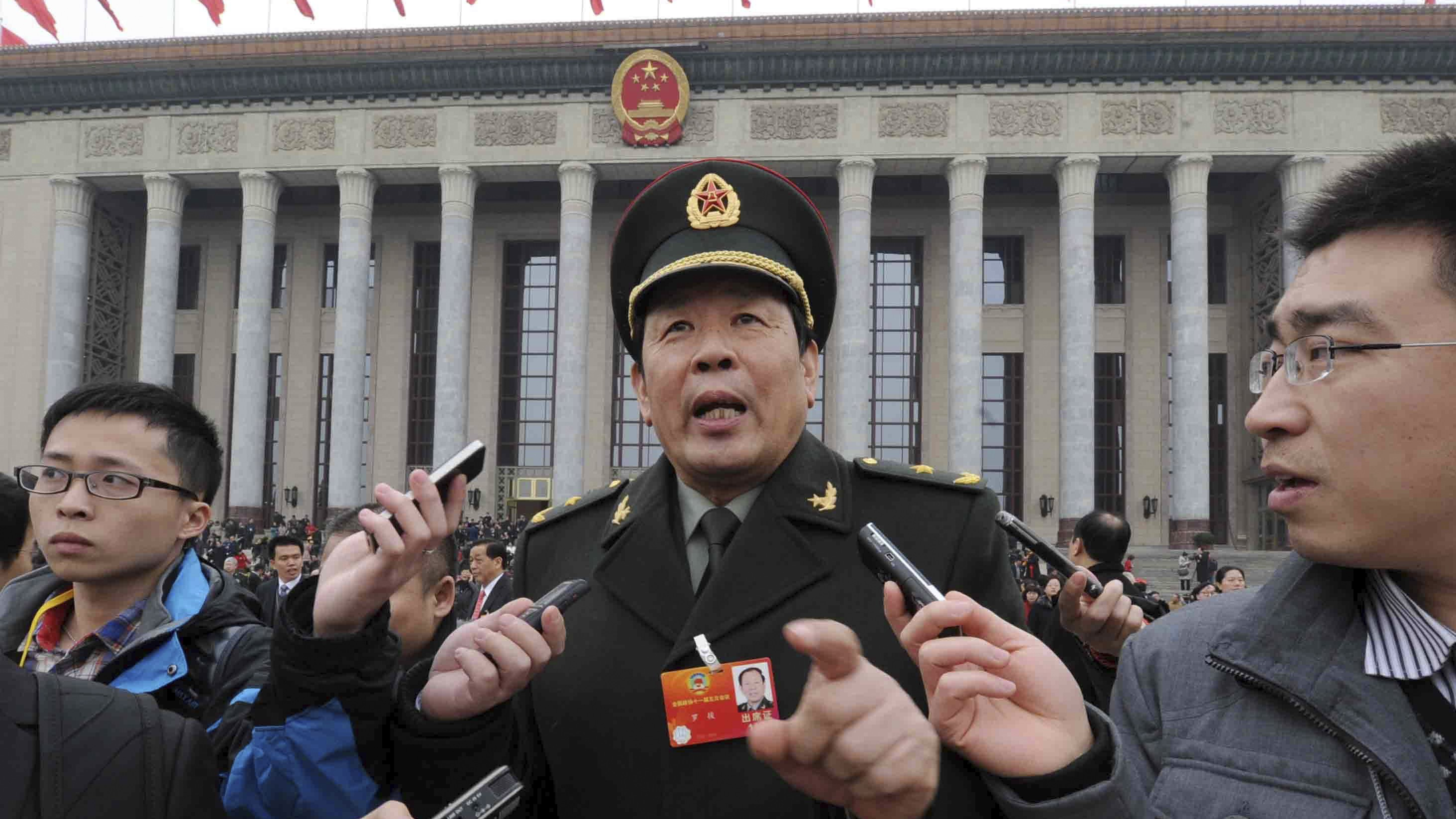People's Liberation Army Major General Luo Yuan speaks to journalists in front of the Great Hall of the People during a session of the Chinese People's Political Consultative Conference (CPPCC) in Beijing March 3, 2012. REUTERS/Stringer (CHINA - Tags: POLITICS MILITARY) CHINA OUT. NO COMMERCIAL OR EDITORIAL SALES IN CHINA - RTR3BXT6