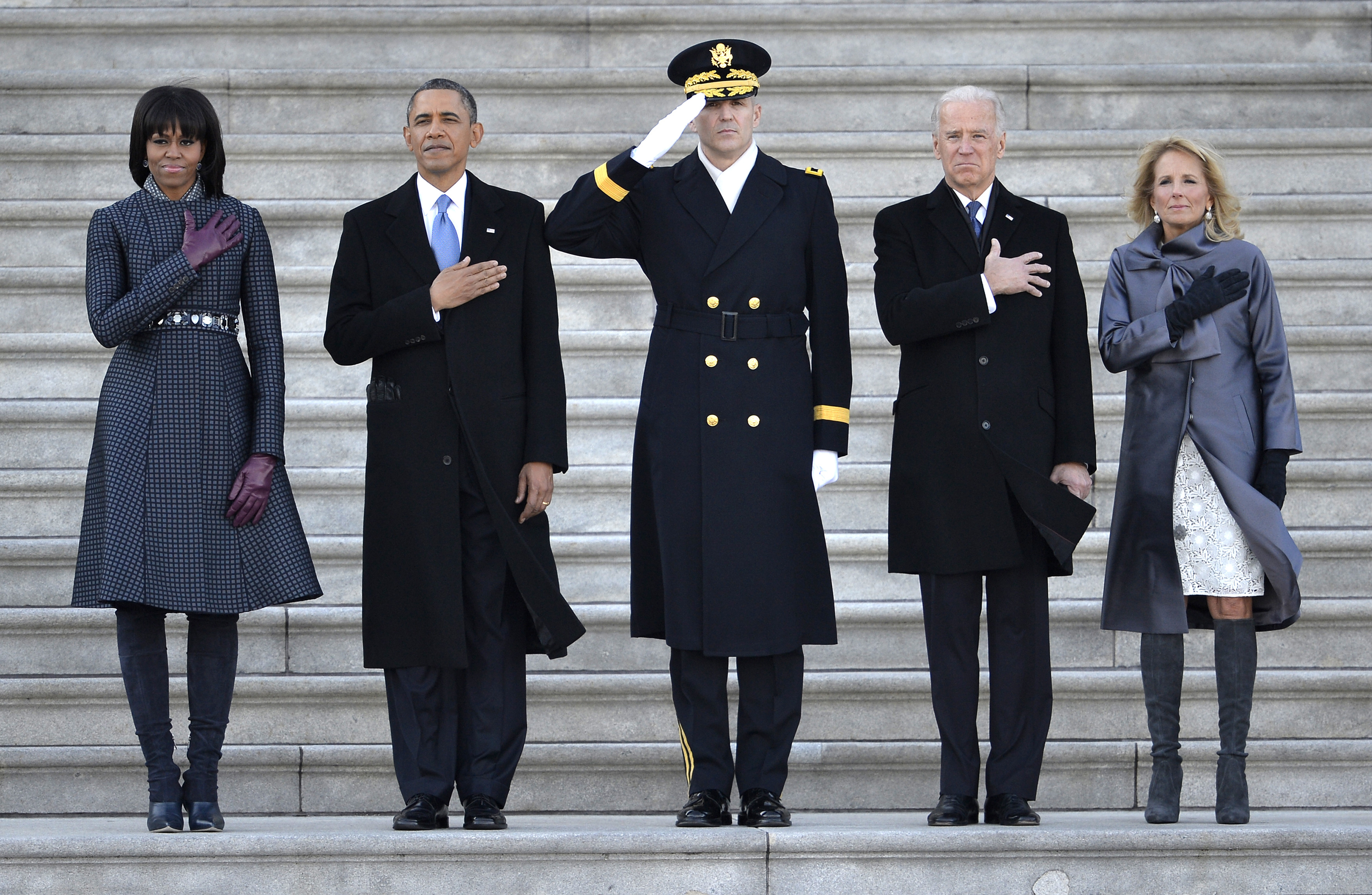 US Army Military District of Washington Major General Michael L. Linnington, Commander JFHQ National Capitol Region (C) is flanked by US President Barack Obama and First Lady Michelle Obama (L side) and Vice President Joe Biden and his wife Jill Biden as they review troops during inauguration ceremonies at the US Capitol, Washington DC, January 21, 2013.          REUTERS/Mike Theiler (UNITED STATES - Tags: POLITICS) - RTR3CRJJ
