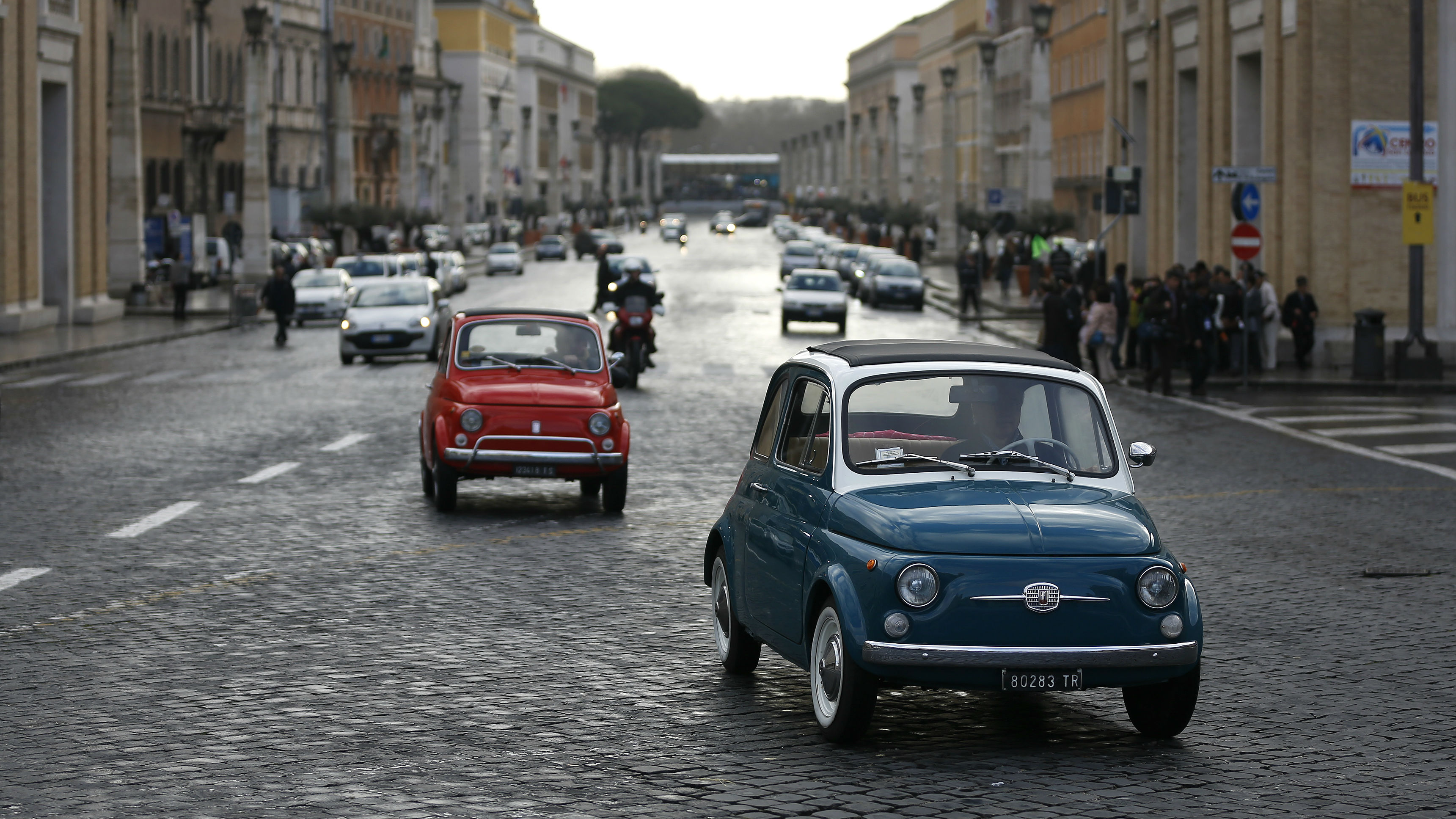 Cars drive on Via della Conciliazione in Rome near Saint Peter's Square at the Vatican, March 11, 2013. Roman Catholic Cardinals will begin their conclave inside the Vatican's Sistine Chapel on Tuesday to elect a new pope. REUTERS/Paul Hanna (ITALY - Tags: RELIGION)