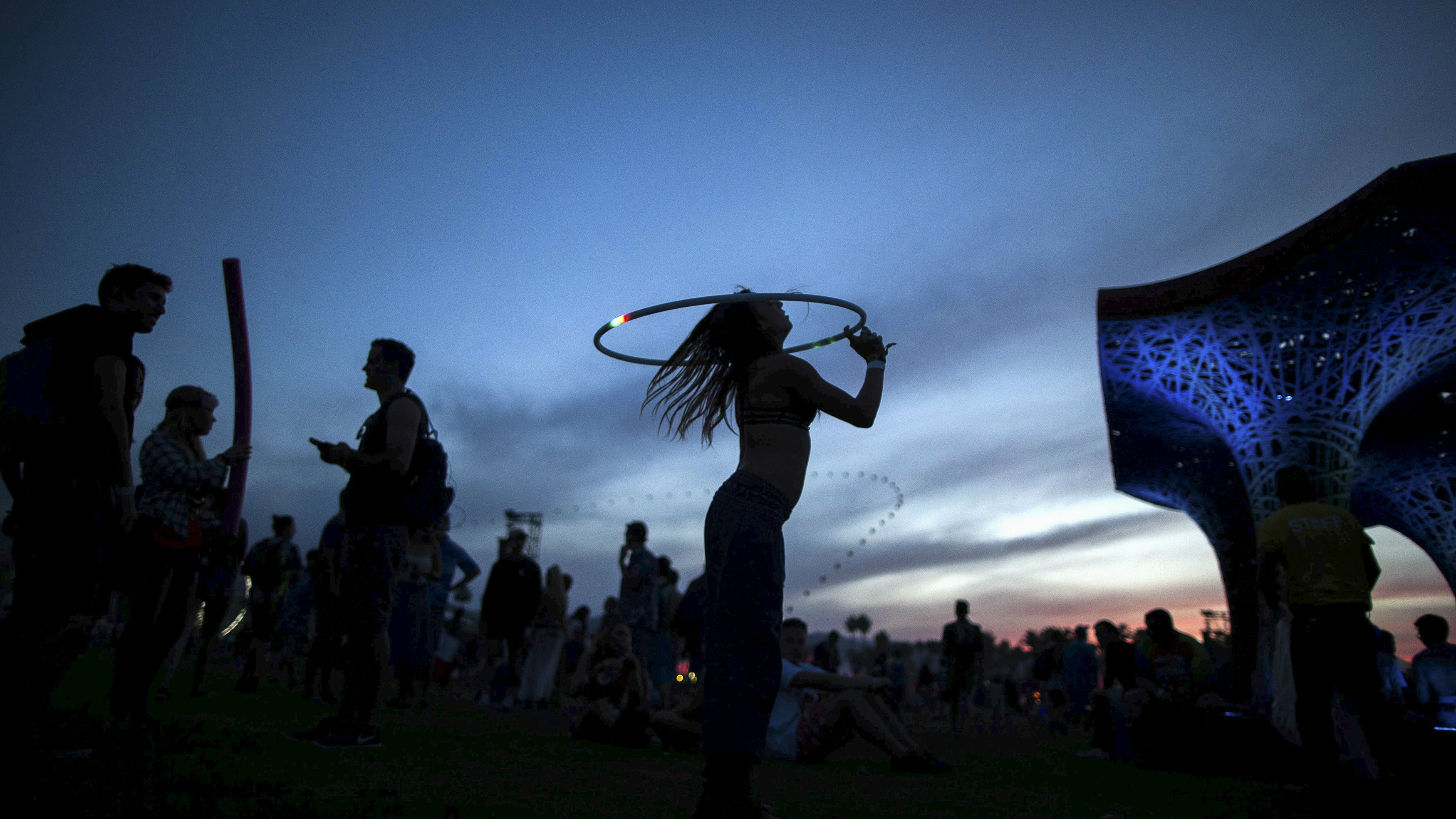A woman dances with a hula hoop at the Coachella Valley Music and Arts Festival in Indio.