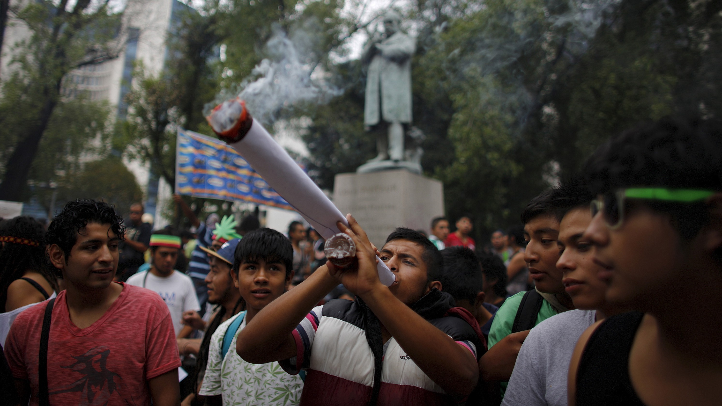 File photo of a man smoking a big joint as his friends look on during a 420 dance party to demand legalisation and to celebrate marijuana culture outside the Senate building in Mexico City