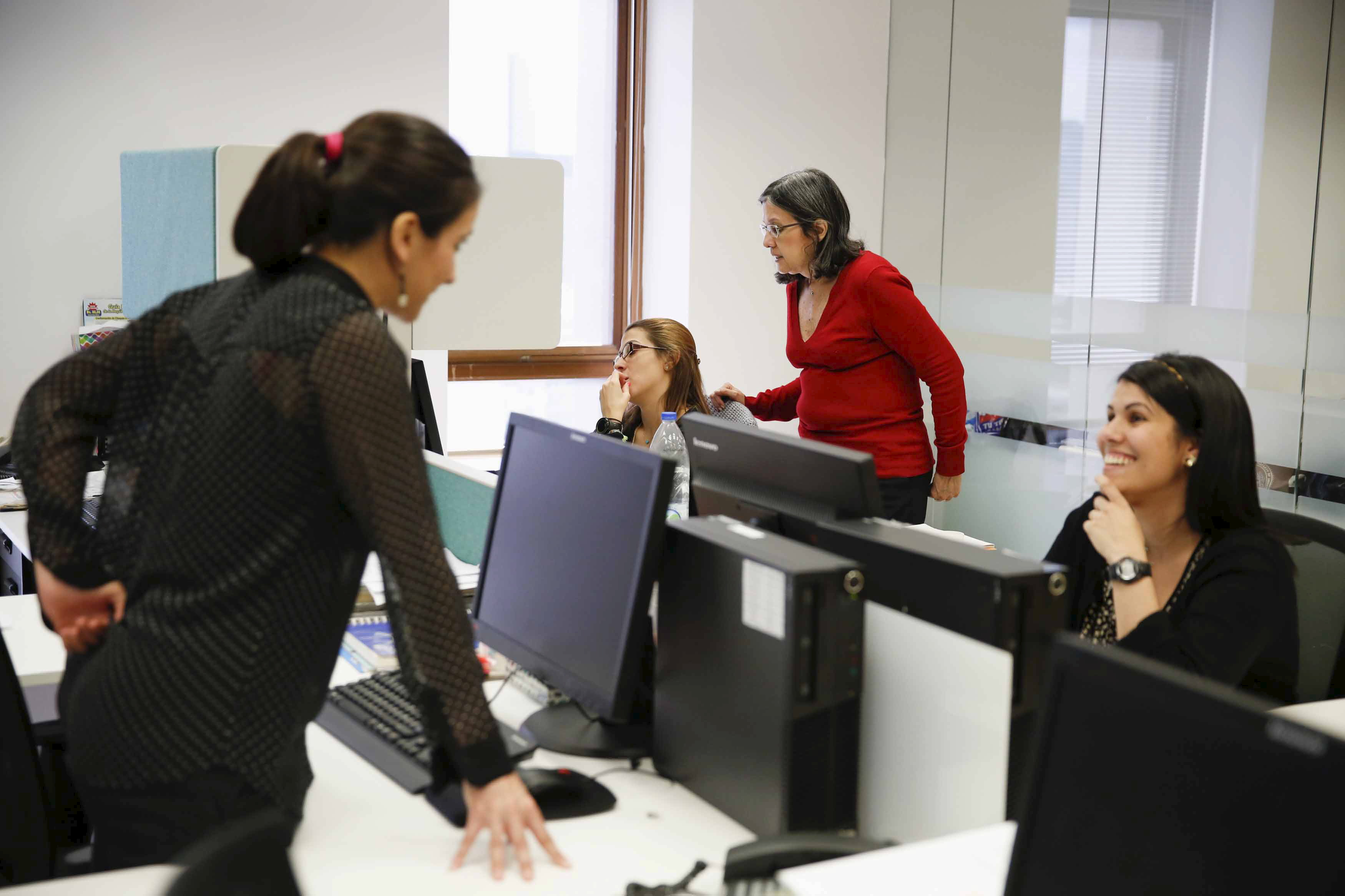 Employees of multinational headhunter Korn/Ferry work at the headquarters office of the company in Caracas