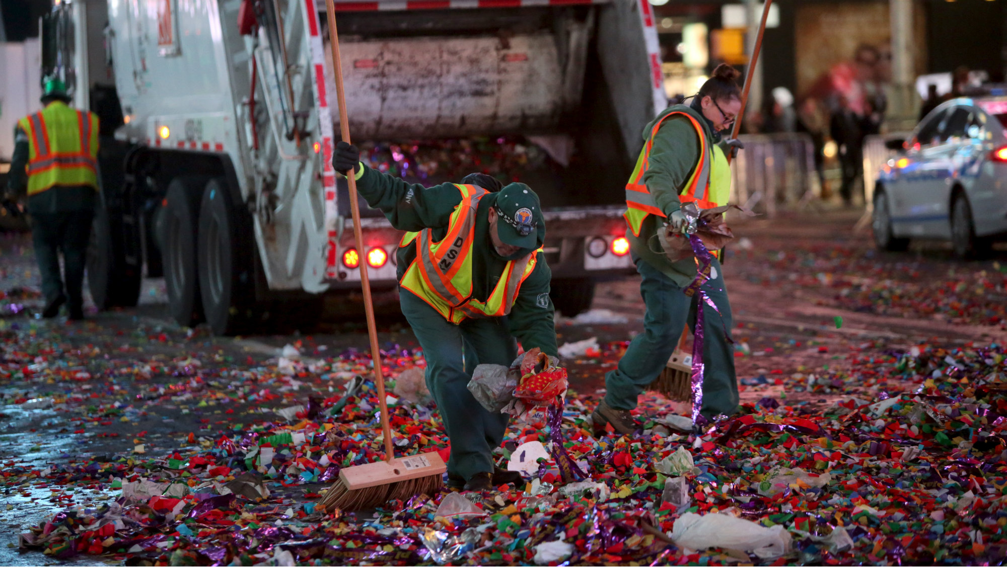 Sanitation workers clean up confetti following New Year celebrations in Times Square in the Manhattan borough of New York January 1, 2016.
