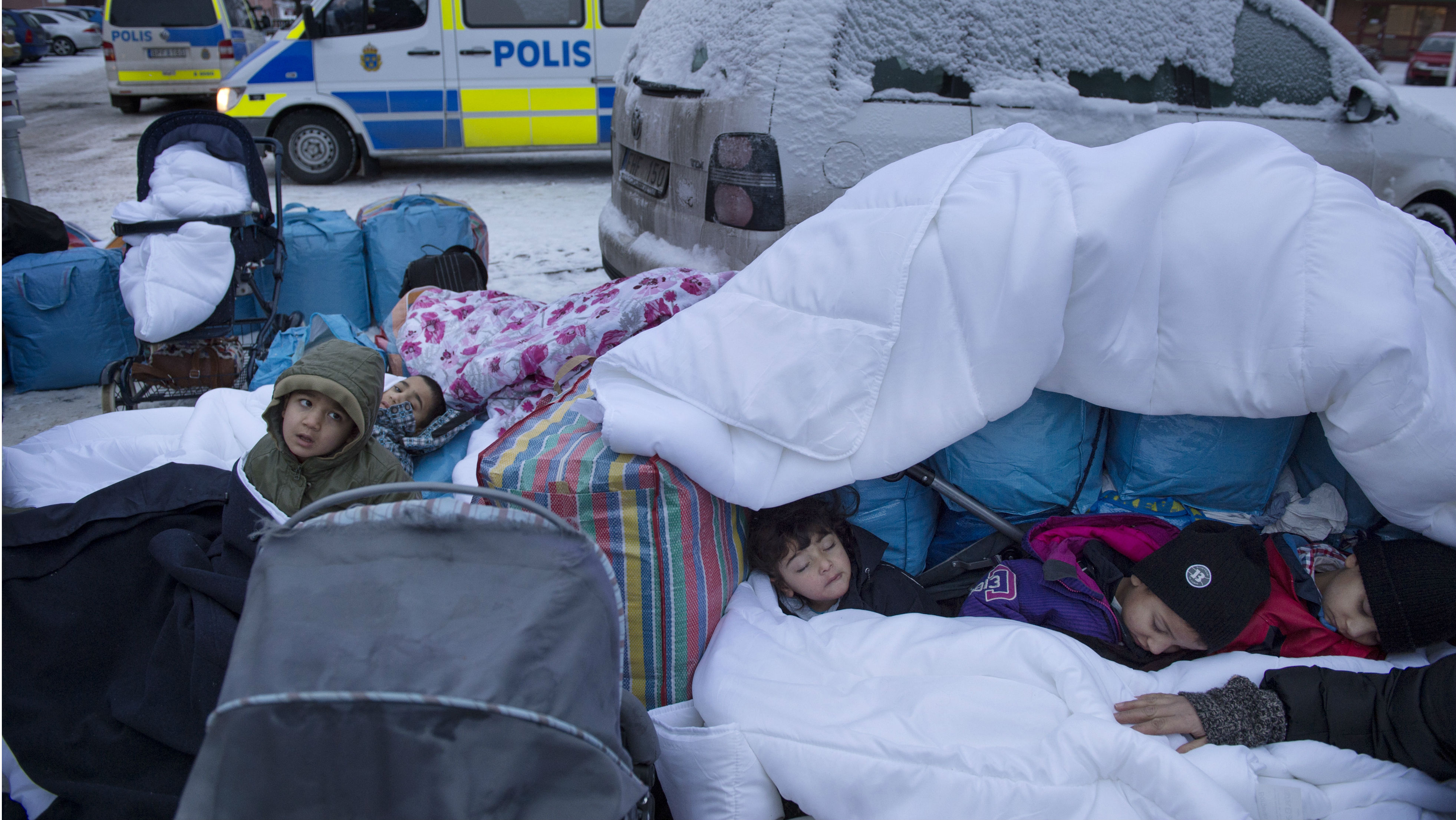 Children Nor, Saleh and Hajaj Fatema from Syria sleep outside the Swedish Migration Board in Marsta, outside Stockholm, Sweden. Picture taken January 8, 2016. REUTERS/Jessica Gow/TT NEWS AGENCY ATTENTION EDITORS - THIS IMAGE WAS PROVIDED BY A THIRD PARTY. FOR EDITORIAL USE ONLY. NOT FOR SALE FOR MARKETING OR ADVERTISING CAMPAIGNS. THIS PICTURE IS DISTRIBUTED EXACTLY AS RECEIVED BY REUTERS, AS A SERVICE TO CLIENTS. SWEDEN OUT. NO COMMERCIAL OR EDITORIAL SALES IN SWEDEN. NO COMMERCIAL SALES.