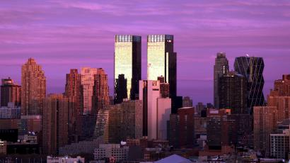 The setting sun reflects off of the twin towers of Time Warner Center in the Manhattan borough of New York City, November 22, 2015.