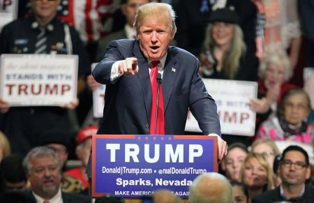 In this Oct. 29, 2015 file photo, Republican presidential candidate Donald Trump in Sparks, Nev. One year before Election Day 2016, Republicans are consumed by uncertainty and infighting while Democrats are coalescing behind Hillary Rodham Clinton. But there's a long way to go.