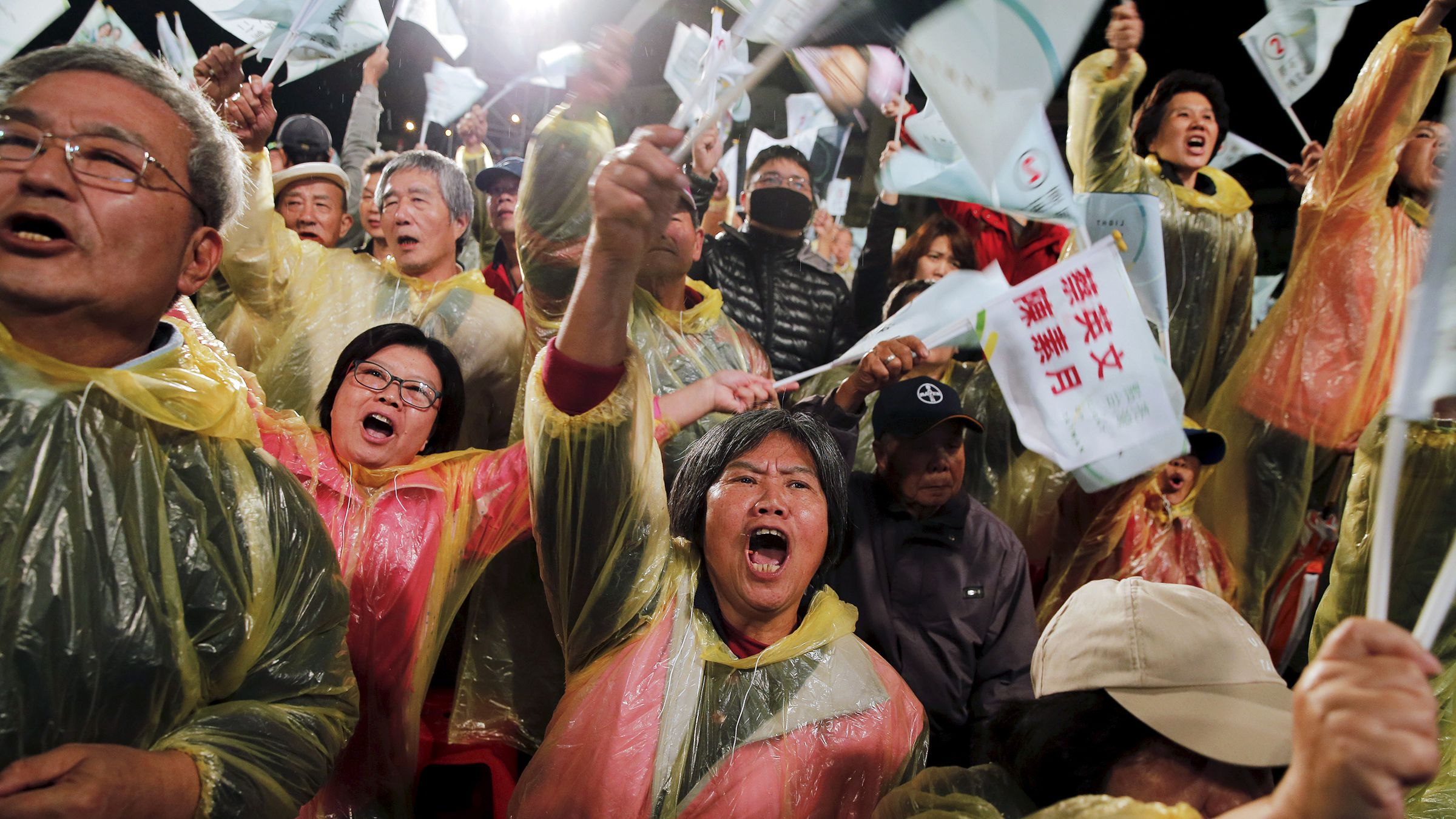 Supporters react as Taiwan's Democratic Progressive Party (DPP) Chairperson and presidential candidate Tsai Ing-wen (unseen) addresses them from the stage during a campaign rally in Wuchi district, Taichung city in central Taiwan January 12, 2016