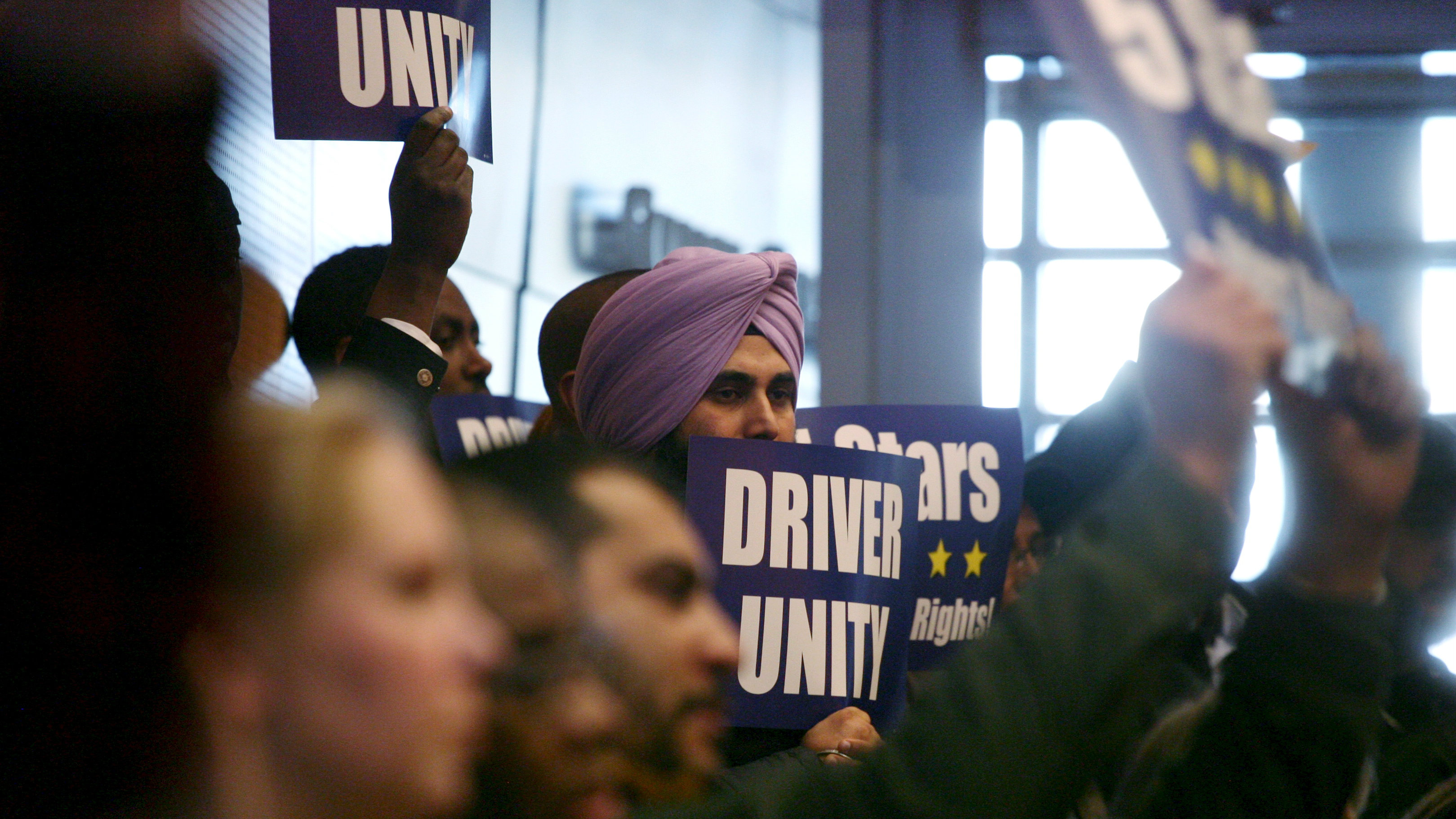 Supporters of ride share unionization is seen cheering at a meeting when the Seattle City Council voted to approve a measure that would allow ride sharing drivers for Uber and Lyft to unionize in Seattle, Washington, December 14, 2015. REUTERS/Matt Mills McKnight