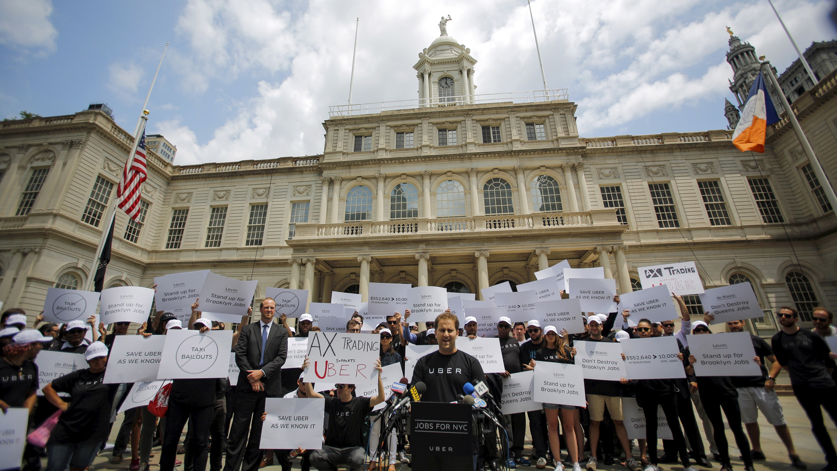 Josh Mohrer, Uber's general manager for New York, leads a rally on the steps of City Hall in July.