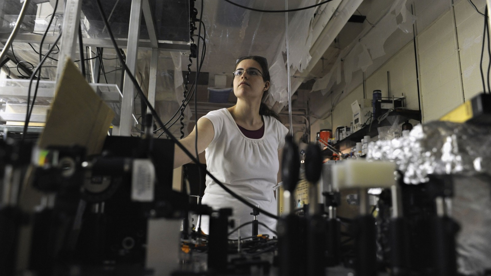 """In this Monday, Sept. 19, 2011 photo, Rebecca Allred, a second-year chemistry doctoral student at Yale, works at Kline Chemistry Laboratory at Yale University in New Haven, Conn. With two-thirds of all undergraduate degrees and 60 percent of master's degrees now going to women, many believe it's only a matter of time before that trend influences the upper echelons of the """"STEM"""" fields - science, technology, engineering and math. (AP Photo/Jessica Hill)"""