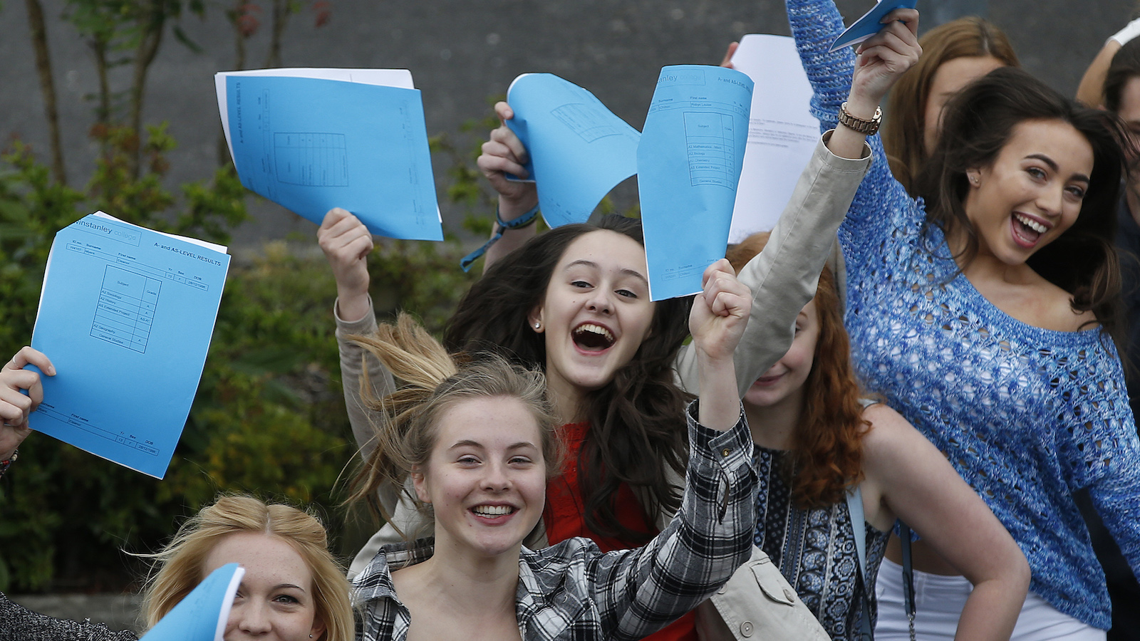 Students celebrate after receiving their A-level results at Winstanley College in Wigan