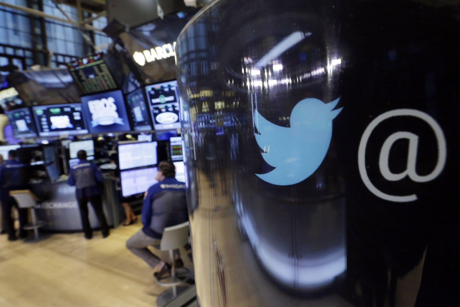 The Twitter logo appears on a phone post on the floor of the New York Stock Exchange, Tuesday, Oct. 13, 2015. Twitter is laying off up to 336 employees, signaling CEO Jack Dorsey's resolve to slash costs while the company struggles to make money. (AP Photo/Richard Drew)