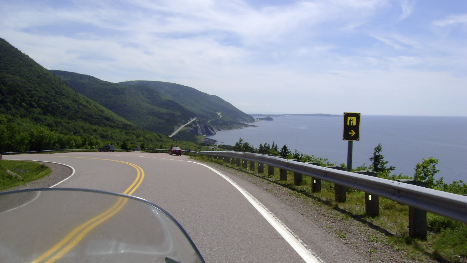 This July 13, 2010 photo shows the road along the eastern edge of Cape Breton Island during a 1,555-mile motorcycle tour along the Cabot Trail in Cape Breton, Nova Scotia.    ()