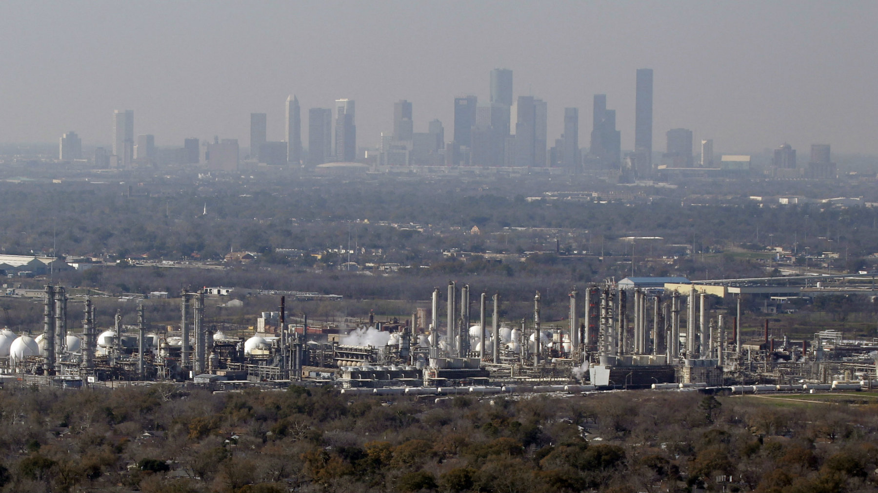 Petrochemical plants and refineries are shown in this aerial view Friday, Jan. 21, 2011 in Deer Park, Texas near downtown Houston. (AP Photo/David J. Phillip)