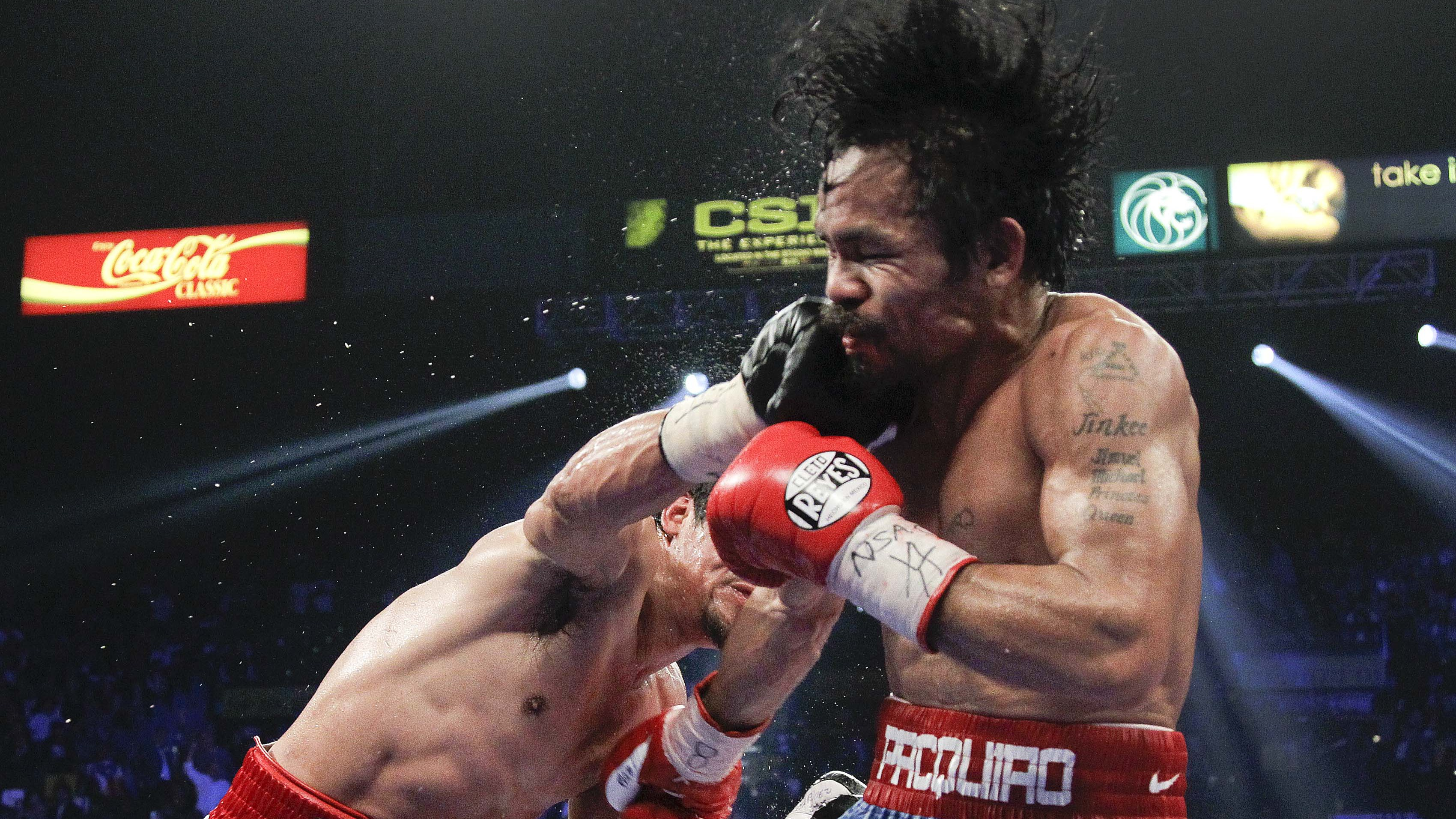 Juan Manuel Marquez, left, lands a punch against Manny Pacquiao during a WBO welterweight title fight Saturday, Nov. 12, 2011, in Las Vegas.