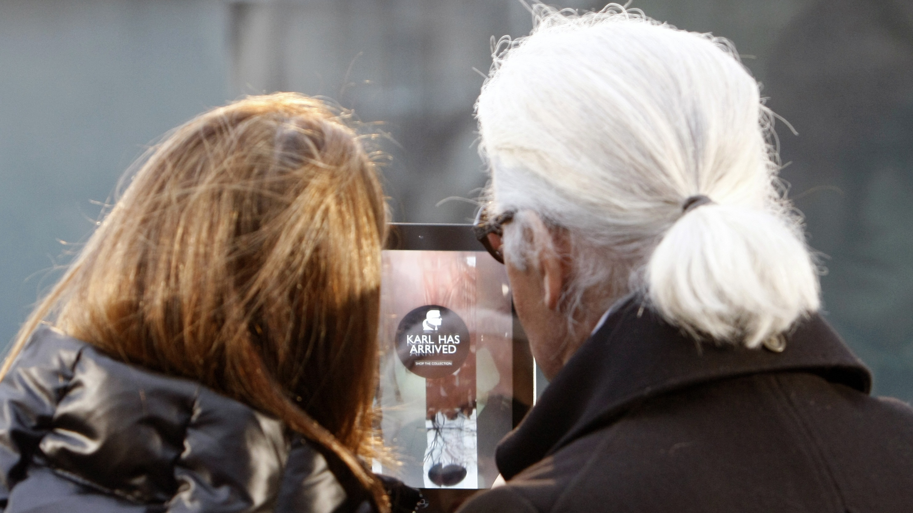 German fashion designer Karl Lagerfeld, right, with net-a-porter founder Natalie Massenet, left, launch the new line: Karl, at place St. Germain des Pres in Paris, Wednesday Jan. 25, 2012. Karl is a collection of covetable downtown classics available on the internet.