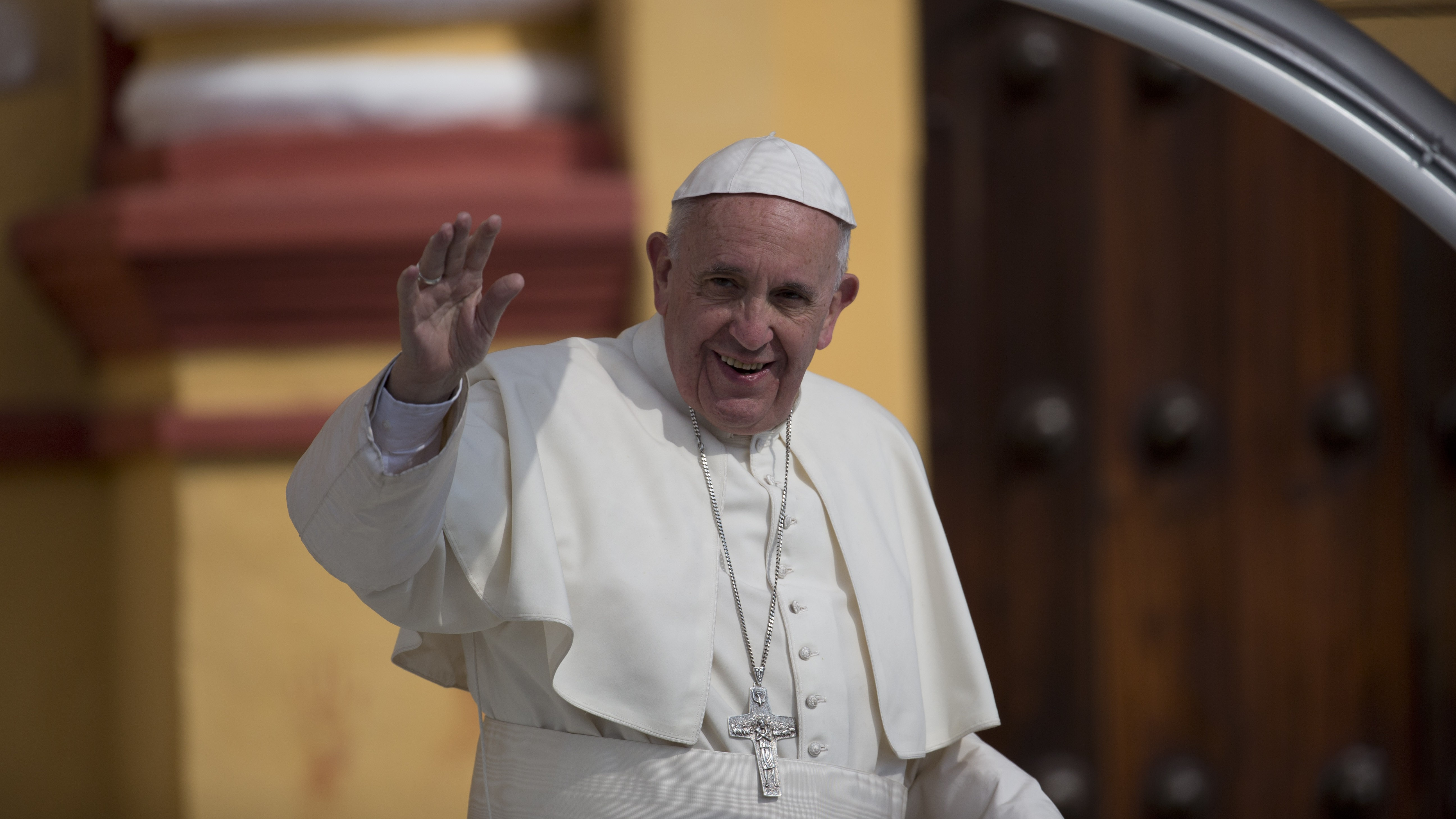 Pope Francis waves to people as he leaves the Cathedral in San Cristobal de las Casas, Mexico, Monday, Feb. 15, 2016. Francis is celebrating Mexico's Indians on Monday with a visit to Chiapas state, a center of indigenous culture, where he presided over a Mass in three native languages thanks to a new Vatican decree approving their use in liturgy. The visit is also aimed at boosting the faith in the least Catholic state in Mexico. ()