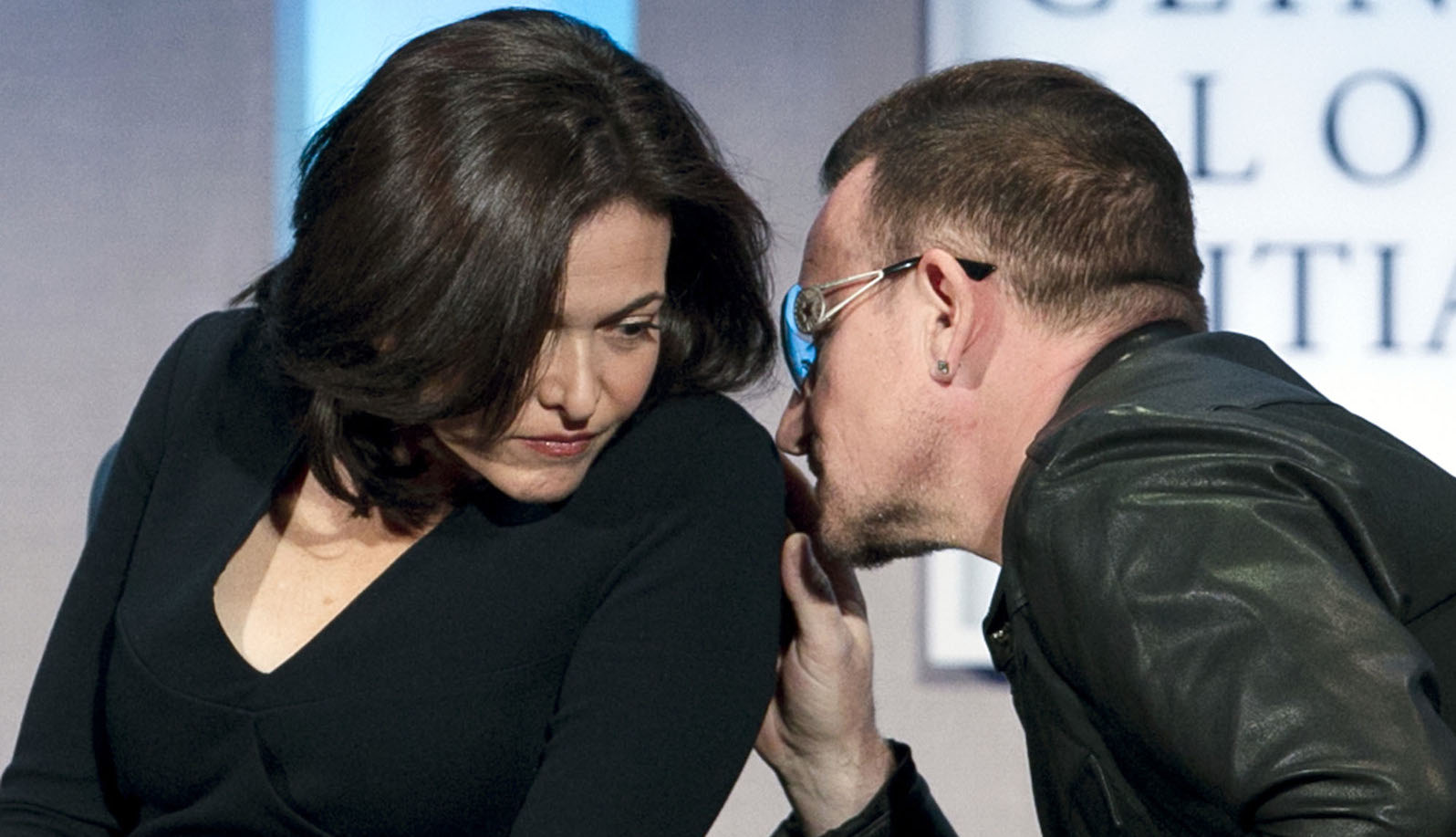Bono, right, leans in to talk with Sheryl Sandberg, the Chief Operating Officer of Facebook, at the Clinton Global Initiative, Tuesday, Sept. 24, 2013 in New York. (AP Photo/Mark Lennihan)