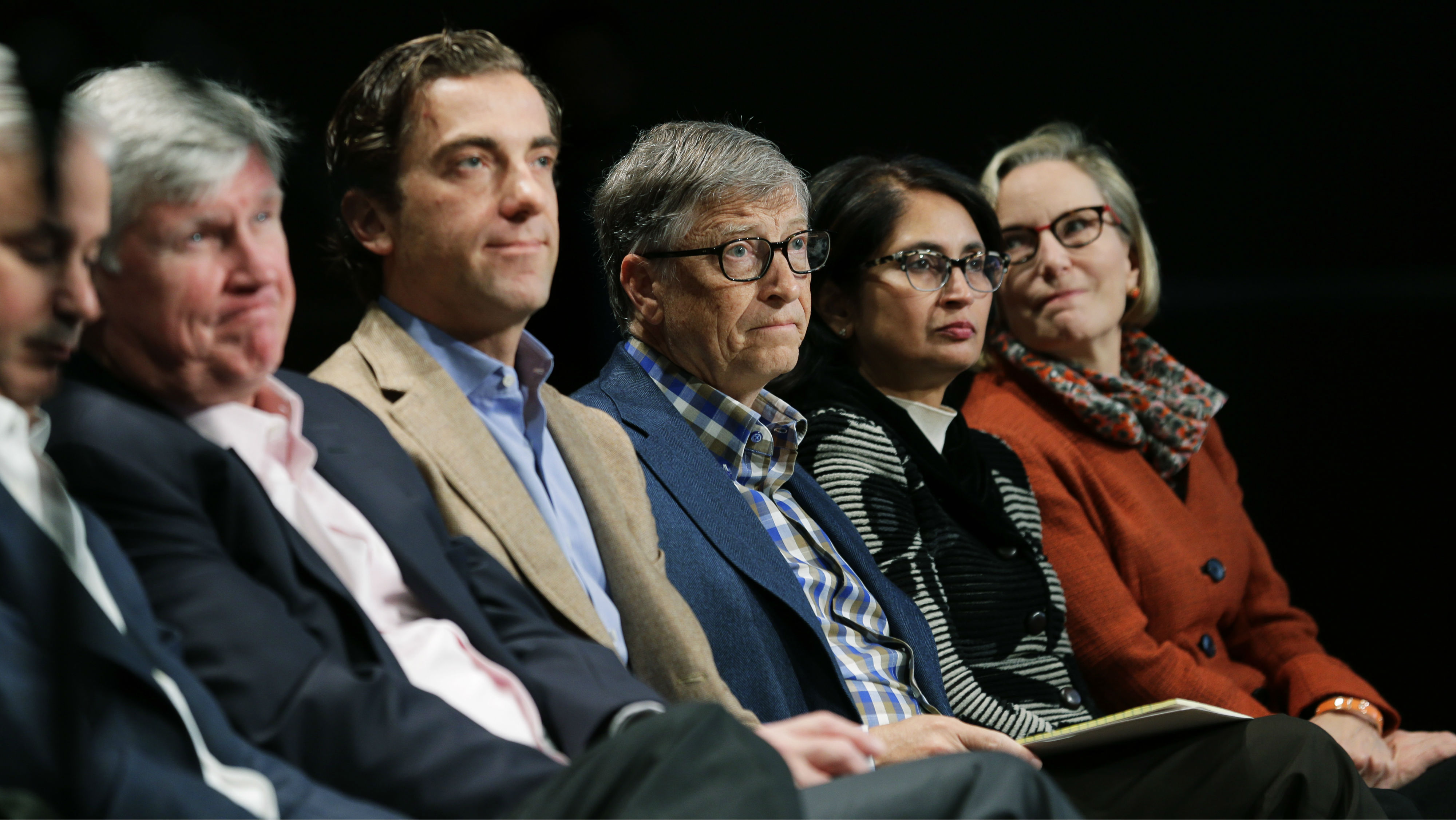 Microsoft Corp. founder Bill Gates, center, attends Microsoft's annual shareholders meeting, Wednesday, Dec. 2, 2015, in Bellevue, Wash. (AP Photo/Ted S. Warren)