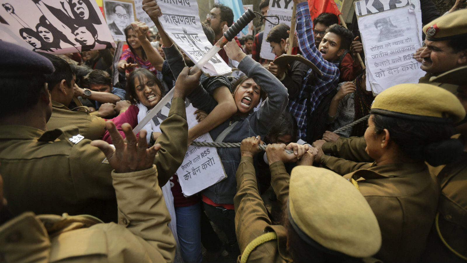Policemen try to stop Indian students as they march towards the office of Hindu nationalist Rashtriya Swayamsevak Sangh (RSS) or the National Volunteers Association's office during a protest against the death of 26-year-old doctoral student Rohith Vemula in New Delhi, India, Saturday, Jan. 30, 2016. Saturday marked the birthday of Vemula whose body was found hanging in a hostel room, on January 17 weeks after he along with four others, was barred from using some facilities at his university in the southern tech-hub of Hyderabad.