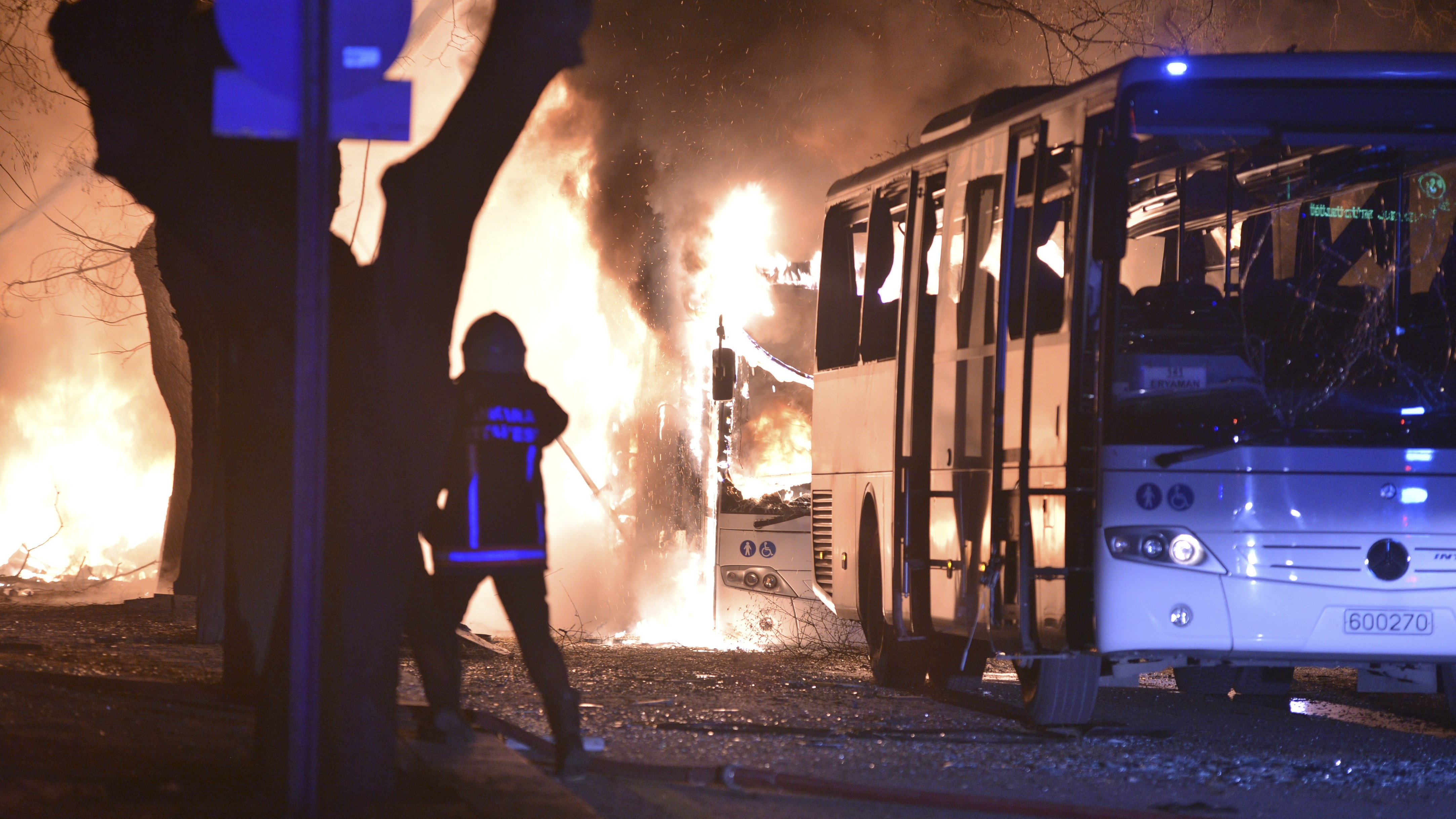 Firefighters work at a scene of fire from an explosion in Ankara, Wednesday, Feb. 17, 2016. A large explosion, believed to have been caused by a bomb, injured several people in the Turkish capital on Wednesday, according to media reports. Private NTV said the explosion occurred during rush hour in an area close to where military headquarters are located as a bus carrying military personnel was passing by. () TURKEY OUT